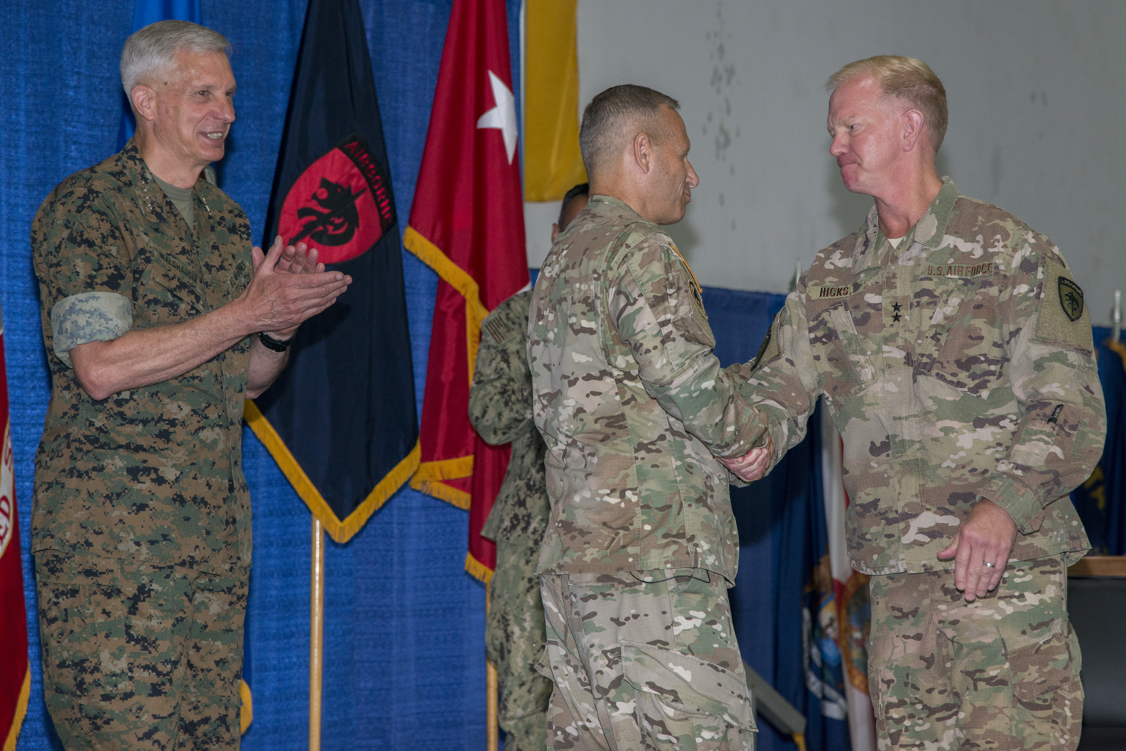 U.S. Air Force Maj. Gen. J. Marcus Hicks, incoming commander of Special Operations Command Africa right shakes hands with U.S. Army Brig. Gen. Donald C. Bolduc, outgoing commander of Special Operations Command Africa, as U.S. Marine Corps Gen. Thomas D. Waldhauser, commander of U.S. Africa Command, looks on during a change of command ceremony for Special Operations Command Africa at Kelley Barracks, Stuttgart, Germany, June 29, 2017. Special Operations Command Africa supports U.S. Africa Command by counter violent extremist organizations, building the military capacity of key partners in Africa and protecting U.S. personnel and facilities. (U.S. Army photo by Visual Information Specialist Eric Steen)