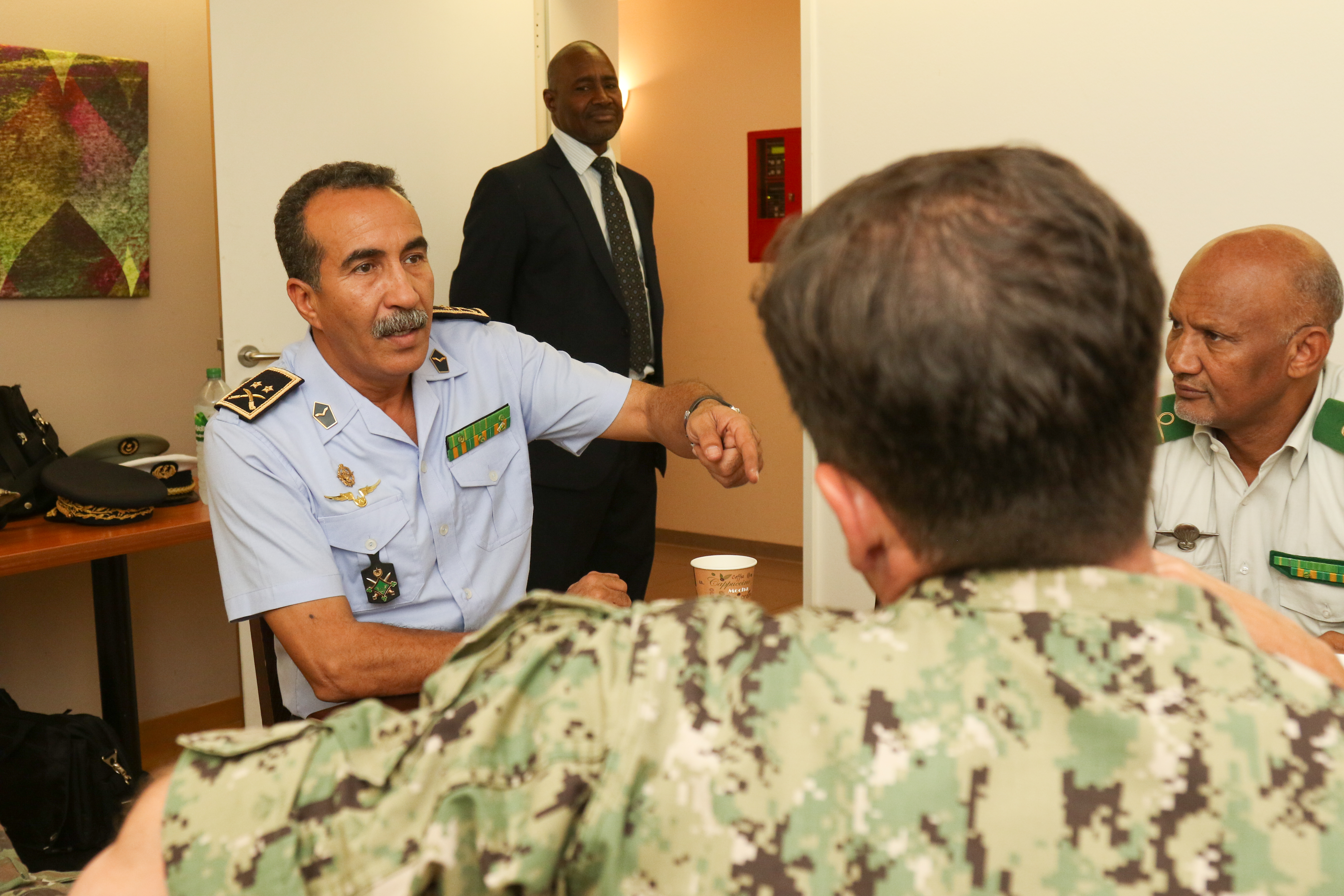 Brig. Gen. Mohamed Lehreitani, Chief of the Mauritanian AirForce, speaks with personnel from U.S. Africa Command and its components, during the annual Mauritanian Country Cooperation meeting held in Stuttgart, Germany July 11-12, 2017. The purpose of the country cooperation meeting is to coordinate defense planning efforts for the upcoming fiscal year and identify areas for future cooperation. (U.S. Navy Photo by Mass Communications Specialist 2nd Class (SW/AW) Dominique J. Shelton RELEASED)