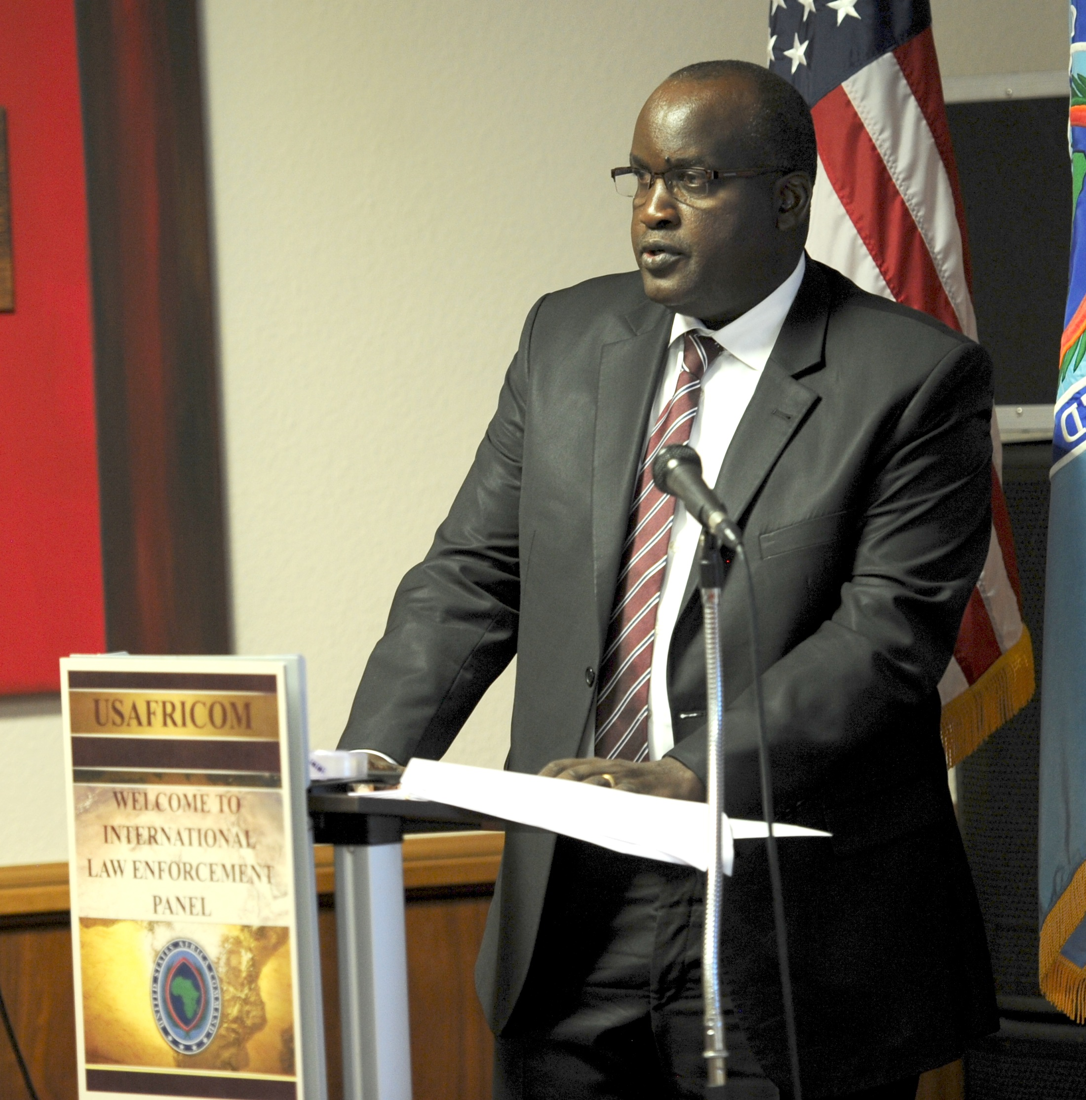 Gedion Kimilu, Head of Bureau for Eastern Africa, International Criminal Police Organization, Kenya, speaks to attendees of U.S. Africa Command's first International Law Enforcement Panel, July 11, 2017, at the U.S. Army Garrison, Stuttgart, Germany. The purpose of the event was to increase understanding of how intergovernmental organizations coordinate law enforcement activities in Africa, while identifying opportunities for collaboration and information sharing between the command and international law enforcement partners.  (U.S. AFRICOM photo by U.S. Army Staff Sgt. Grady Jones/Released)