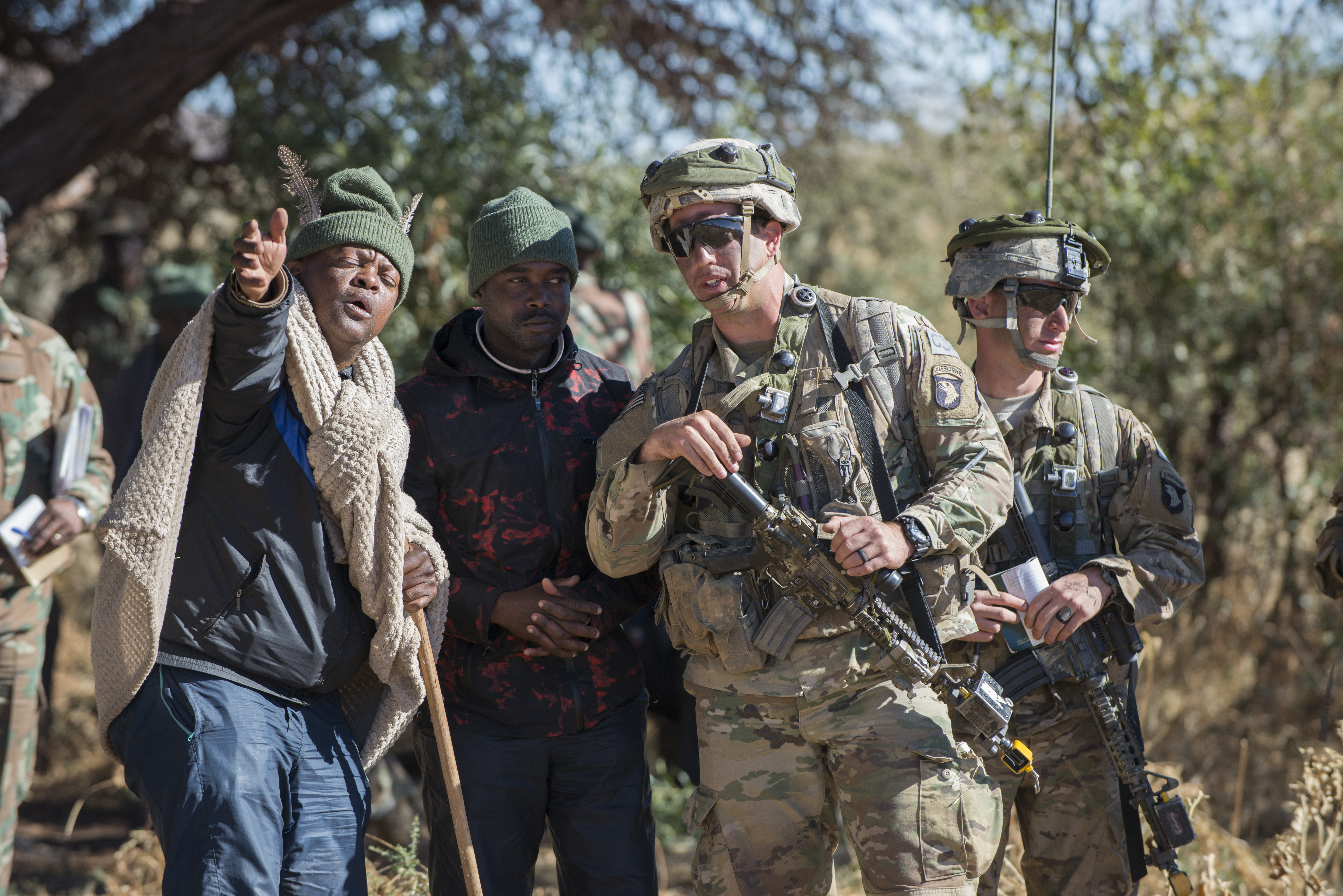 First Lt. Zach Lewis, right, a platoon leader with 101st Airborne Division's 2nd Battalion, 327th Infantry Regiment, speaks with a village elder played by a South African soldier during situational training for Shared Accord 17 at the South African Army Combat Training Center in Lohatla, July 21, 2017. The elder told the Soldiers that a family member had been kidnapped by insurgents and he needed their help. The two-week exercise, which ends Aug. 3, enhances the peacekeeping capabilities of U.S. and African forces. (Photo by Sean Kimmons Army News Service)