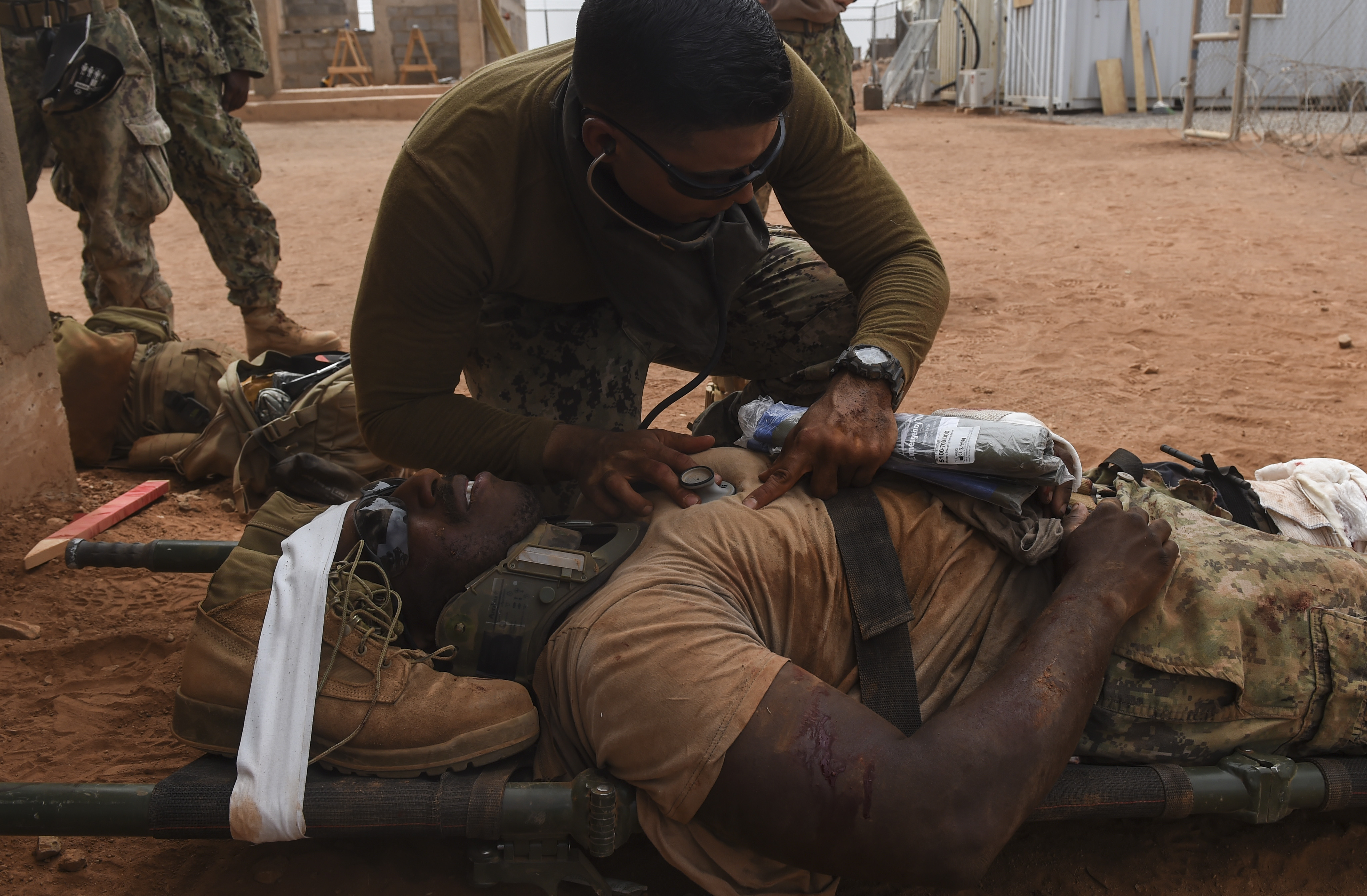 U.S. Navy Hospital Corpsman 3rd Class David Rojas from the Naval Mobile Construction Battalion One, a maneuver unit of the Combined Joint Task Force-Horn of Africa, uses a stethoscope to listen to a patient's heartbeat during a bilateral exercise with French forces in the Arta region, July 19, 2017. This bilateral training was the first execution of medical evacuation procedures with French military personnel and increases the ability of all participants to plan, communicate and execute complex operations. (U.S. Air Force photo by Staff Sgt. Eboni Prince/Released)