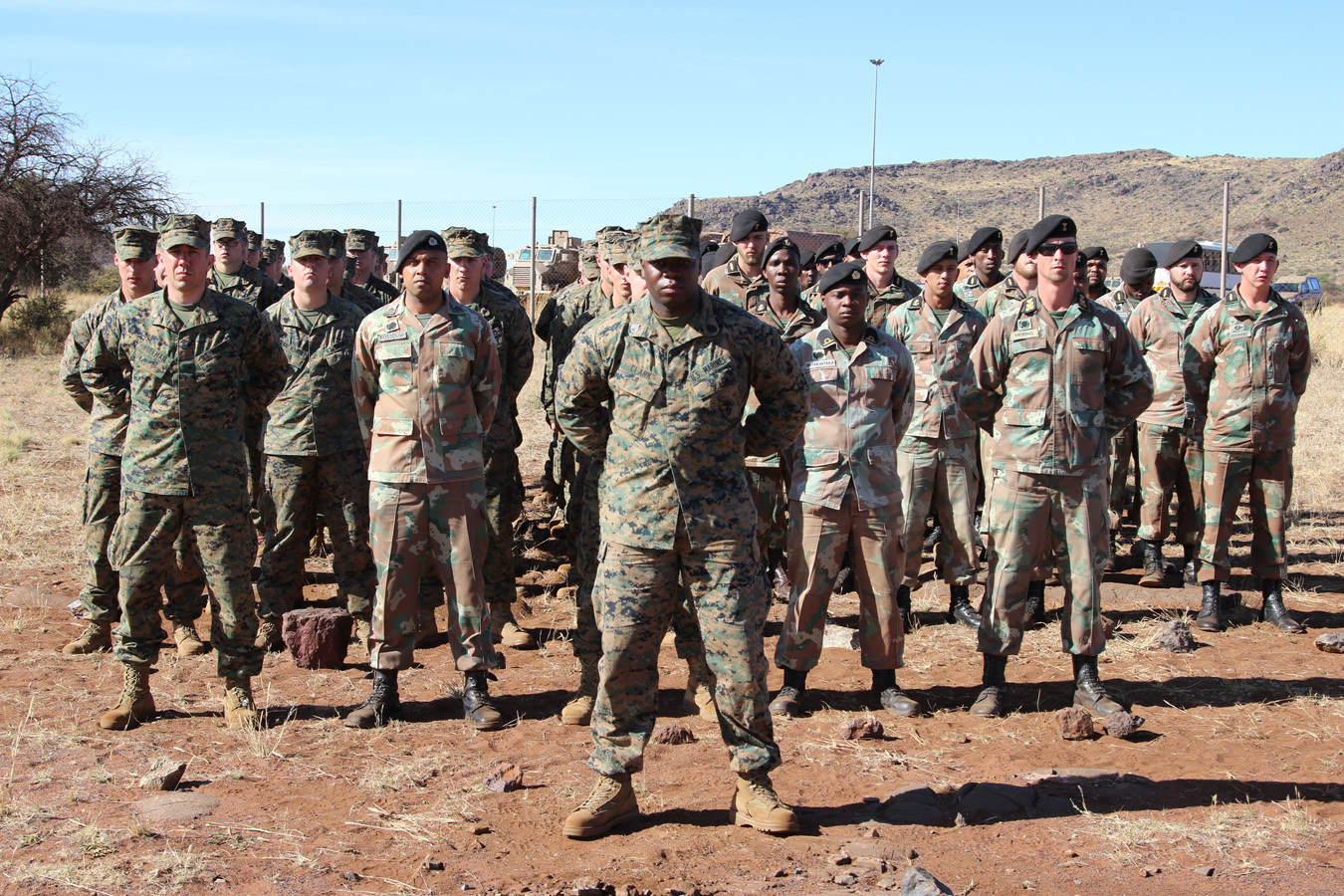 U.S. and South African Marines gathered for the opening ceremony of Shared Accord 2017 at the South African Army Combat Training Center, Lohatla, South Africa. During SA 17, South African and U.S. forces train together in areas such as counter-IED training, strong point defense and offensive operations and Peacekeeping scenarios. The exercise culminates with a unilateral, combined arms maneuver live-fire demonstration.