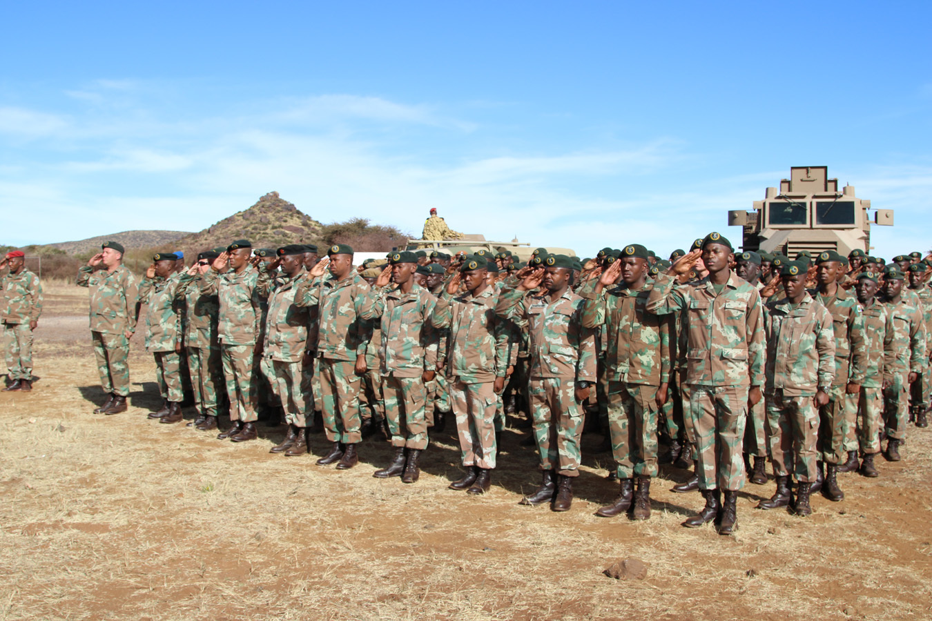 A platoon of South African soldiers salute during the playing of the South African and U.S. National Anthems during the opening ceremony for Shared Accord 2017 at the South African Army Combat Training Center, Lohatla, South Africa. During SA 17, South African and U.S. forces trained together in areas such as counter-IED training, strong point defense and offensive operations and Peacekeeping scenarios. The exercise culminates with a unilateral, combined arms maneuver live-fire demonstration.
