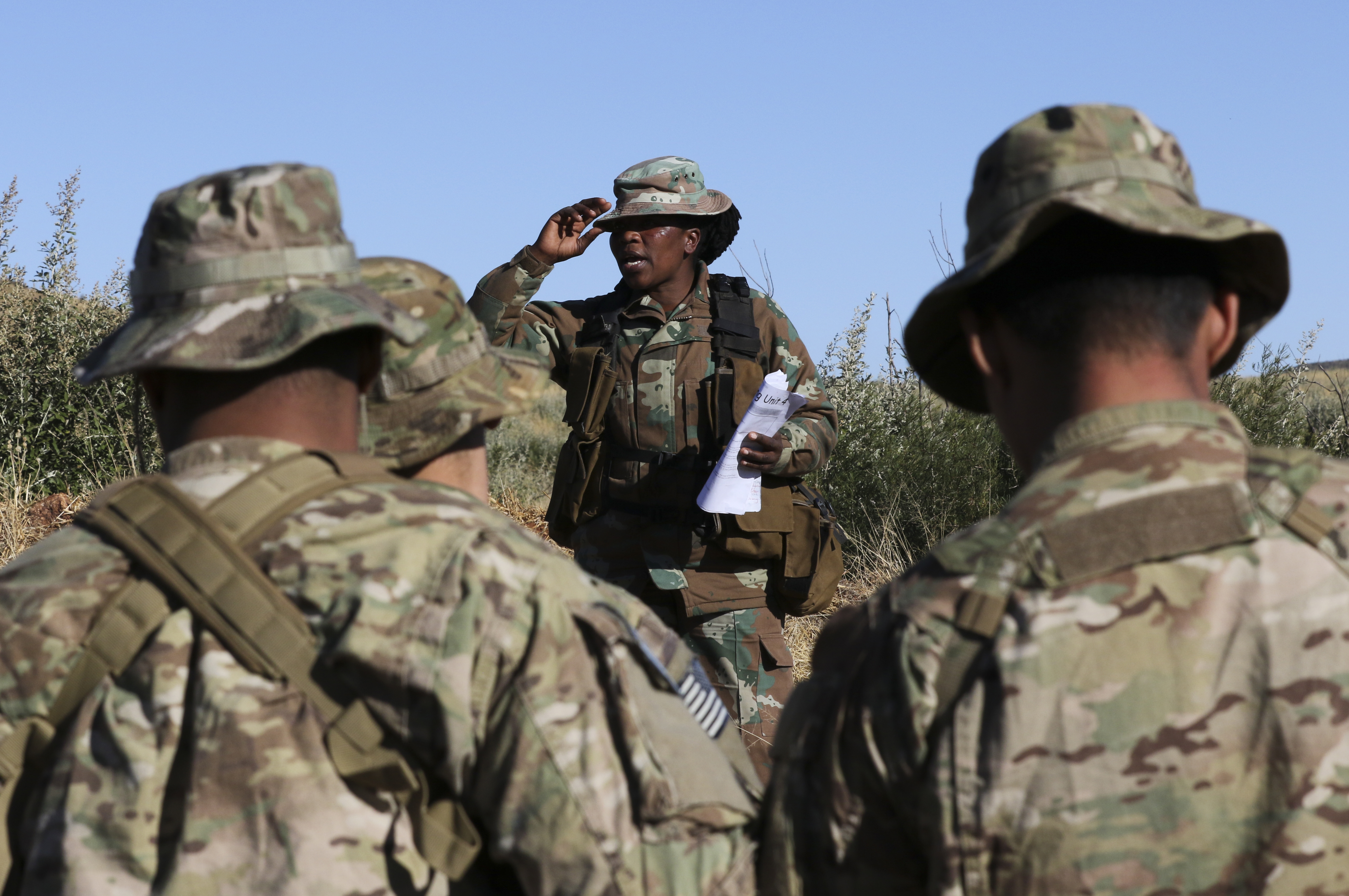 A member of the South African National Defense Force instructs U.S. Marines from 3rd Battalion, 25th Marine Regiment and South African troops from the South African Navy, Maritime Reaction Squadron in bush terrain survival July 19, 2017, during Exercise Shared Accord 2017 at the South African Army Combat Training Center in Lohatla, South Africa. (U.S. Army photo by Sgt. 1st Class Alexandra Hays, 79th Sustainment Command (Support).