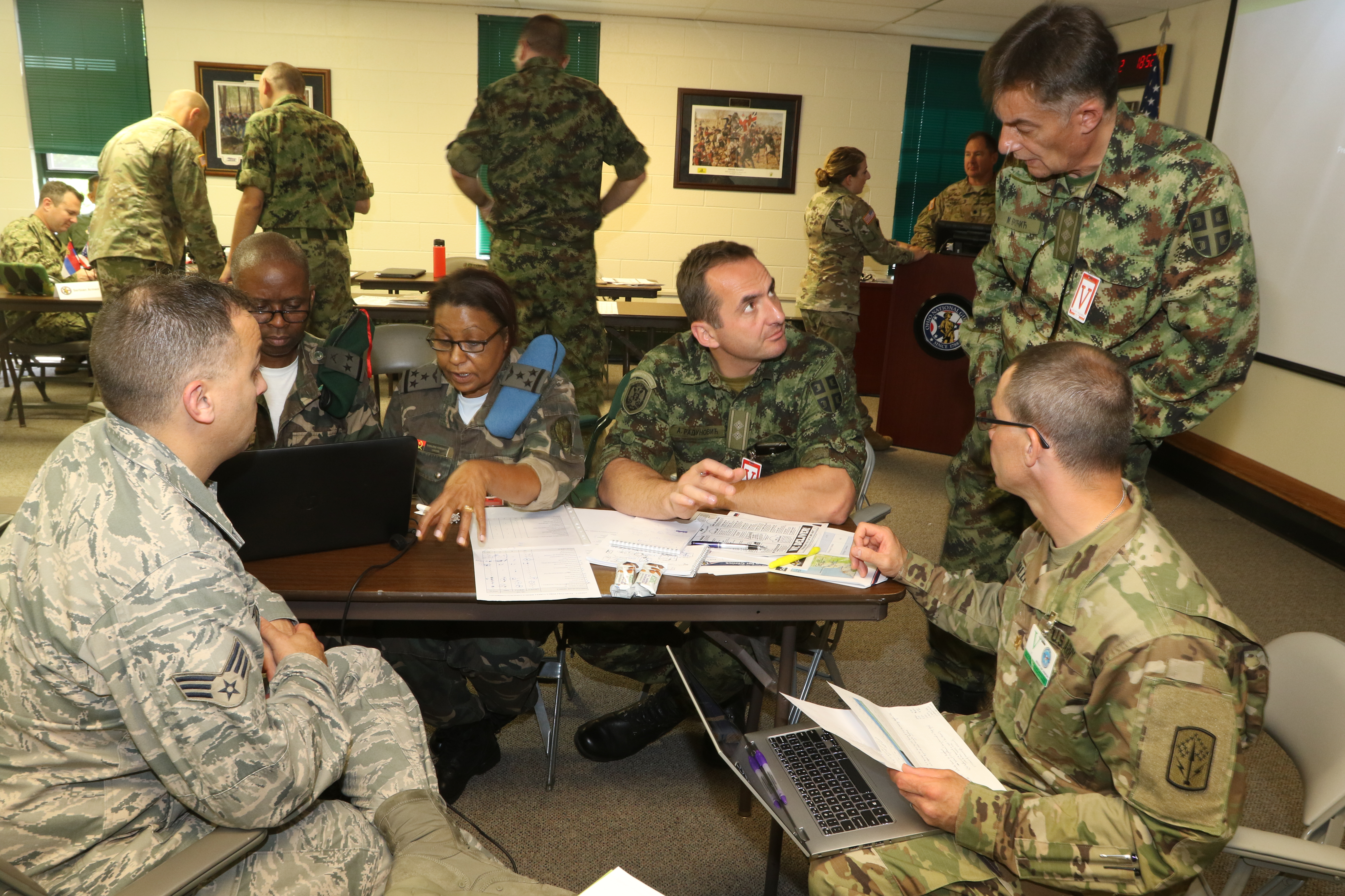 Representatives from the Serbian and Angolan Armed Forces meet with members of the Ohio National Guard June 28, 2017, at Joint Force Headquarters-Ohio, located at the Maj. Gen. Robert S. Beightler Armory in Columbus, Ohio. The group discussed plans for an upcoming Combined Medical Engagement set to take place in Angola later this year. (Ohio National Guard photo by Staff Sgt. Michael Carden)