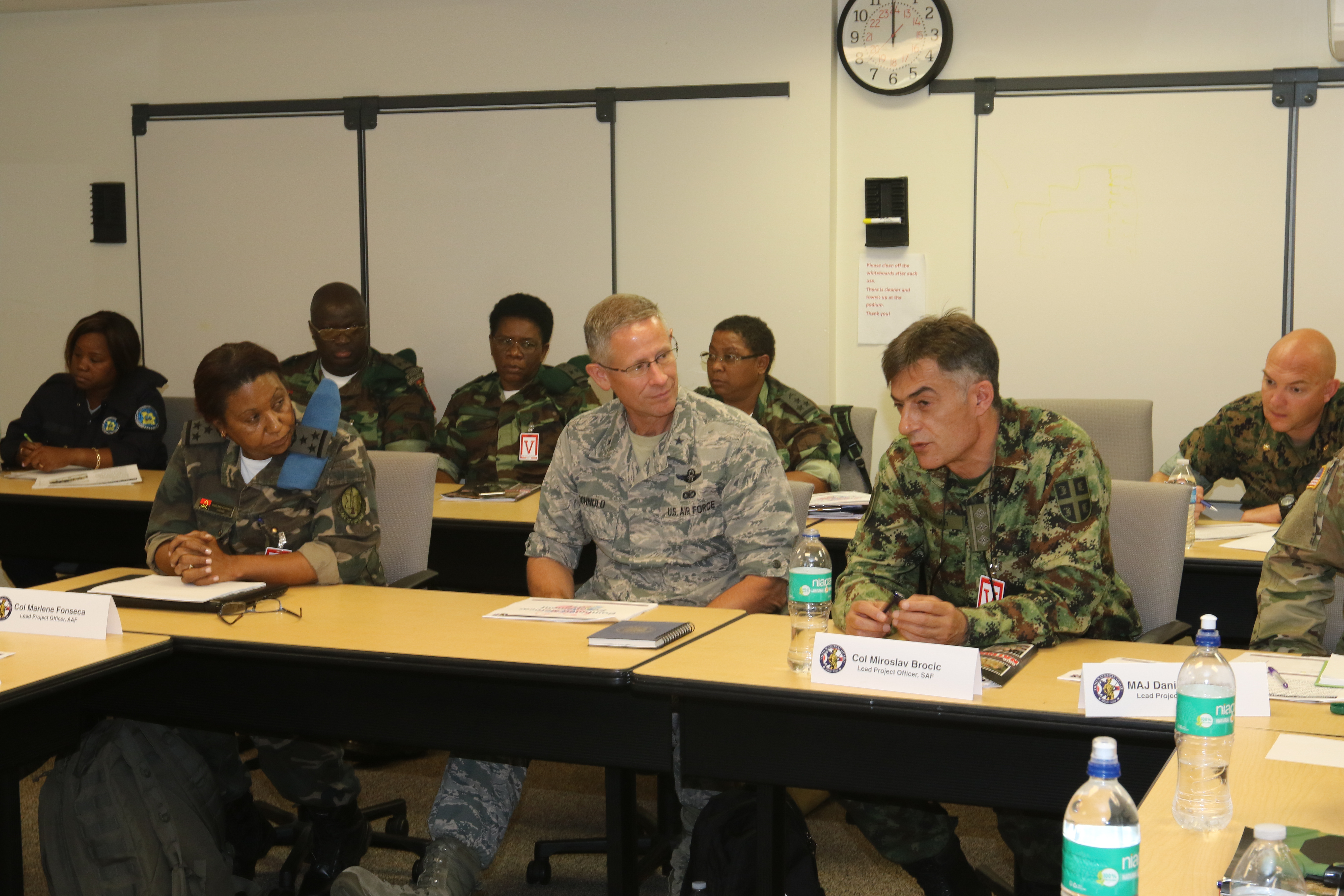 Representatives from the Serbian and Angolan Armed Forces meet with members of the Ohio National Guard to plan a Combined Medical Engagement June 29, 2017, at Joint Force Headquarters-Ohio, located at the Maj. Gen. Robert S. Beightler Armory in Columbus, Ohio. In this photo, Col. Miroslav Brocic (right), lead project officer for the Serbian Armed Forces, discusses a point while Col. Marlene Fonseca (left), lead project officer for the Angolan Armed Forces, and Brig. Gen. Gregory N. Schnulo, Ohio assistant adjutant general for Air, listen. (Ohio National Guard photo by Staff Sgt. Michael Carden)