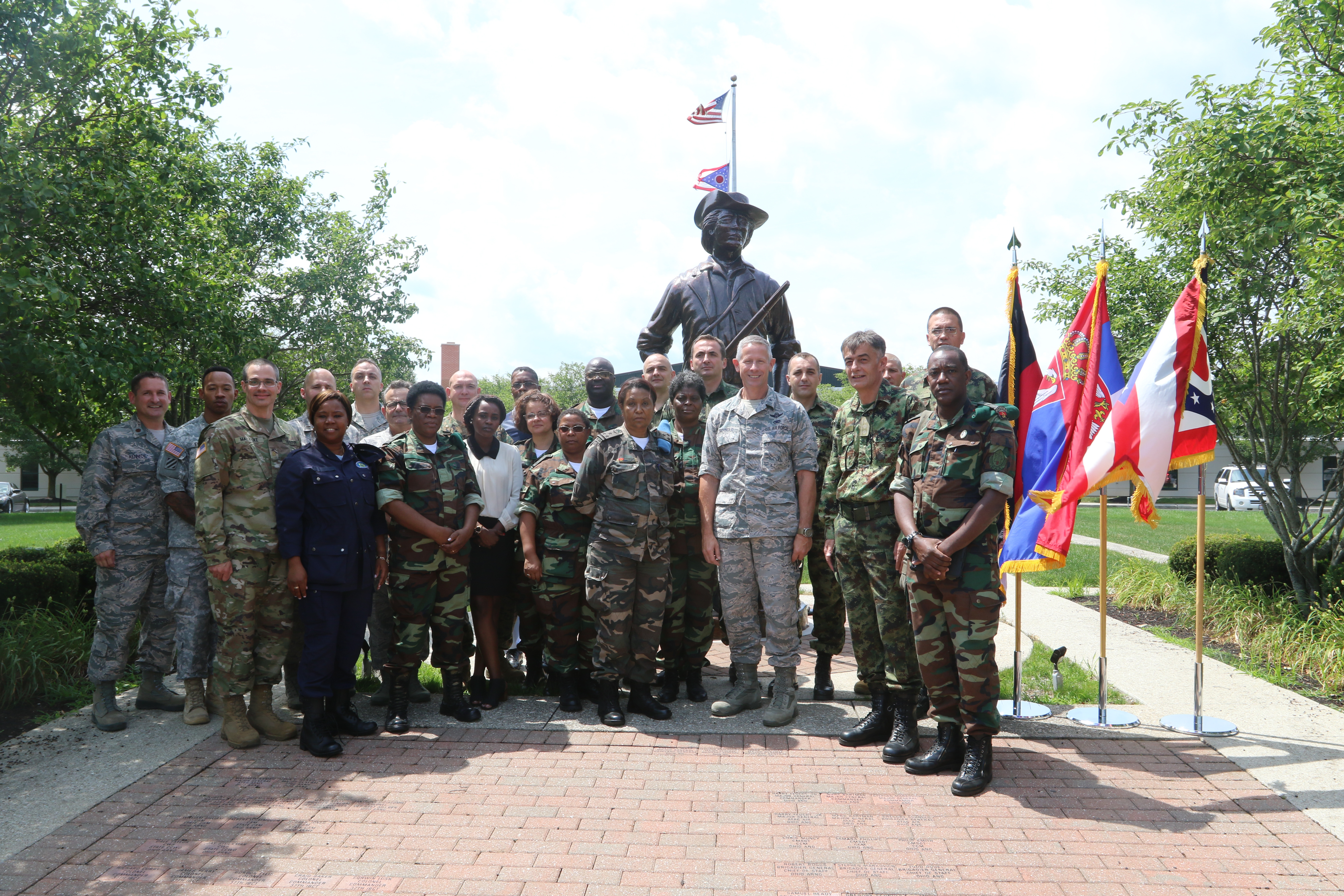 Representatives from the Serbian and Angolan Armed Forces meet with members of the Ohio National Guard June 29, 2017, at Joint Force Headquarters-Ohio, located at the Maj. Gen. Robert S. Beightler Armory in Columbus, Ohio. The group, which stopped for a photo in front of the National Guard minuteman statue at ONG headquarters, discussed plans for an upcoming Combined Medical Engagement set to take place in Angola later this year. (Ohio National Guard photo by Staff Sgt. Michael Carden)