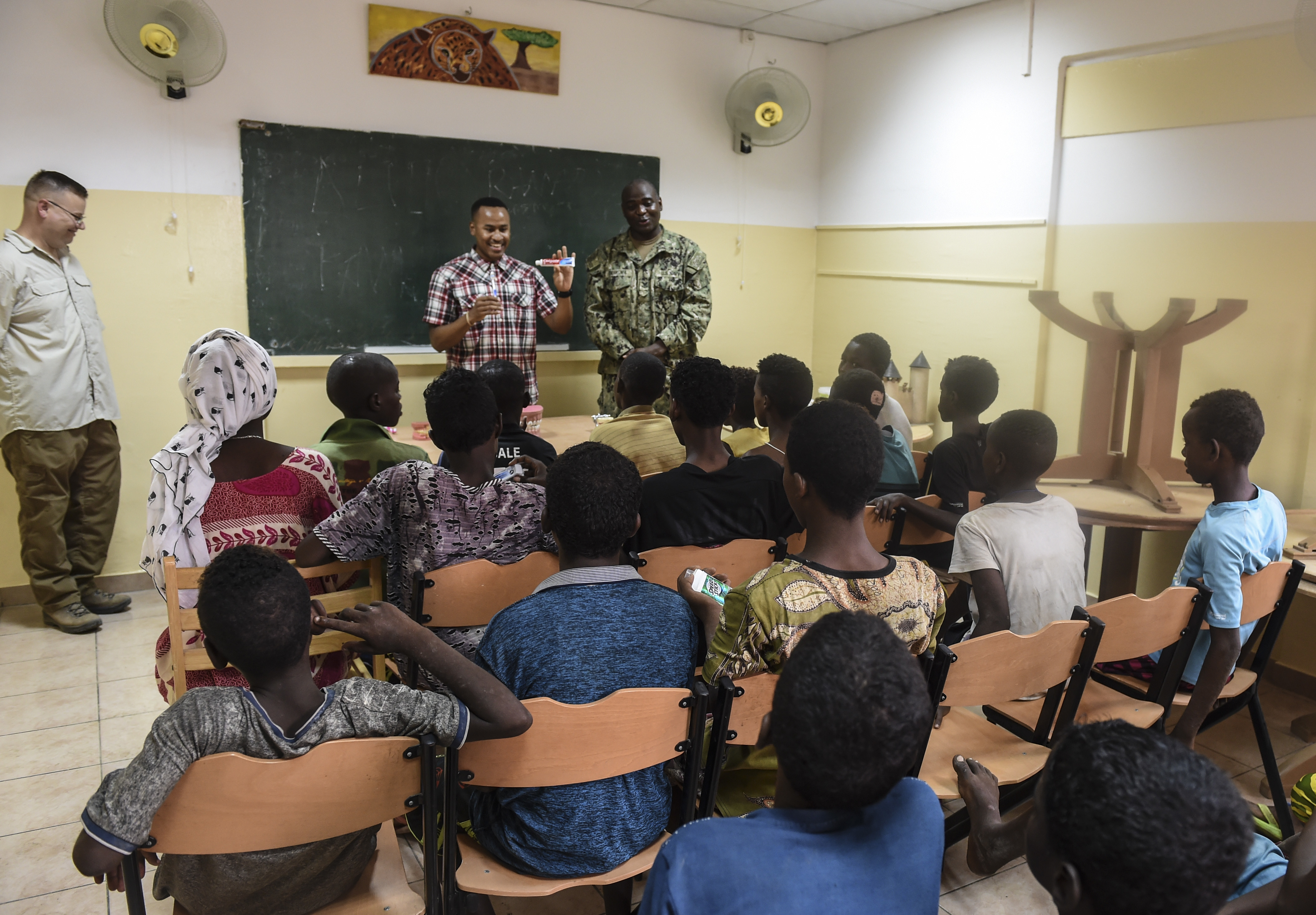 U.S. Army SGT Justin Wallace, a dental specialist with the 443rd Civil Affairs Battalion functional specialty team, shows children a tube of toothpaste during a dental demonstration in Djibouti City, Djibouti, Aug. 8, 2017. With demonstrations such as these, the team contributes to the Combined Joint Task Force-Horn of Africa's efforts to promote regional security, stability and prosperity. (U.S. Air Force photo by Staff Sgt. Eboni Prince)