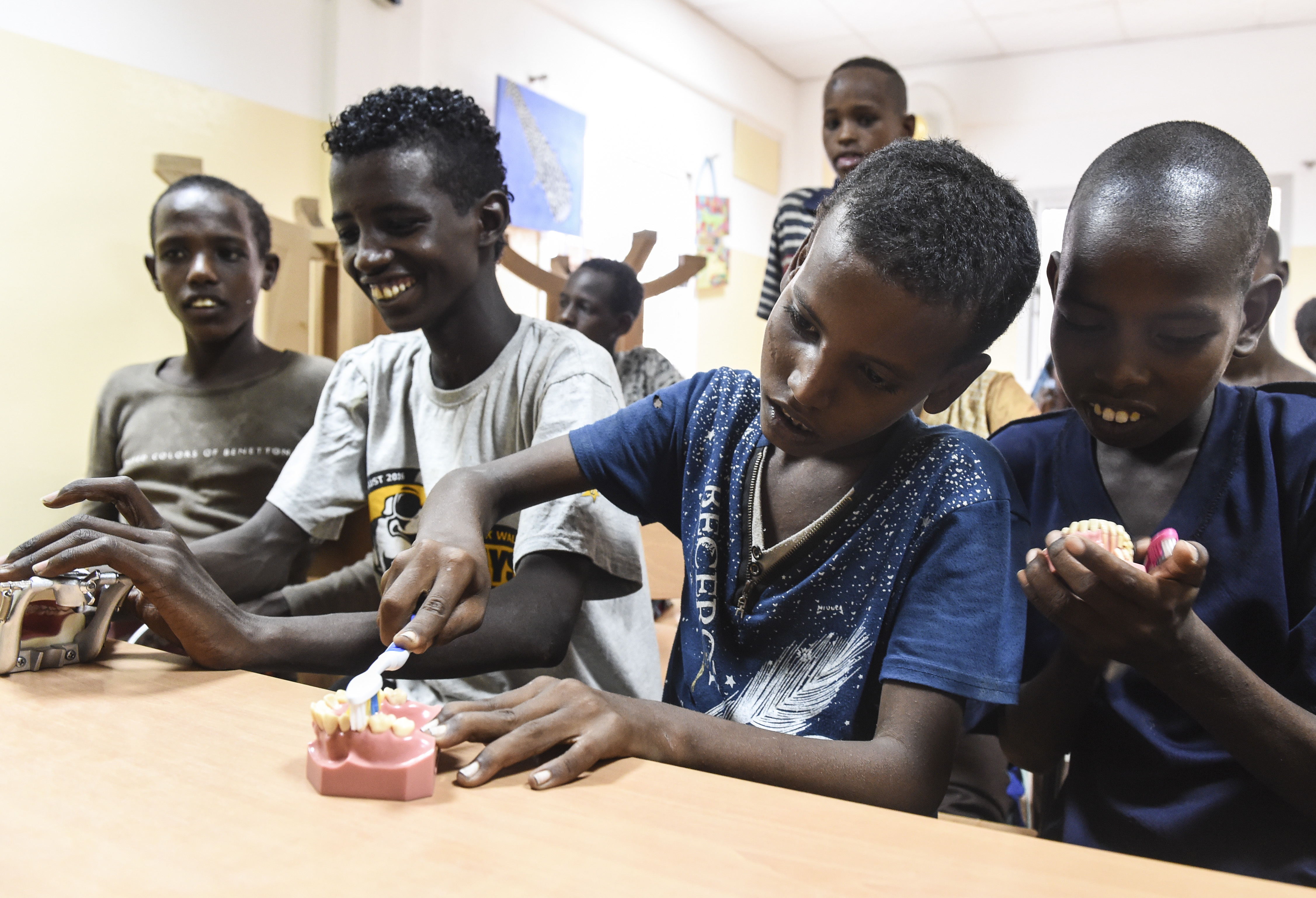 Children use dental typodonts during an oral hygiene demonstration at Caritas Djibouti, a humanitarian organization in Djibouti City, Djibouti, Aug. 8, 2017. In support of Combined Joint Task Force-Horn of Africa's efforts to promote regional security and stability, the 443rd Civil Affairs Battalion functional specialty team conducted multiple oral hygiene instruction classes for approximately 60 children from the local area. (U.S. Air Force photo by Staff Sgt. Eboni Prince)