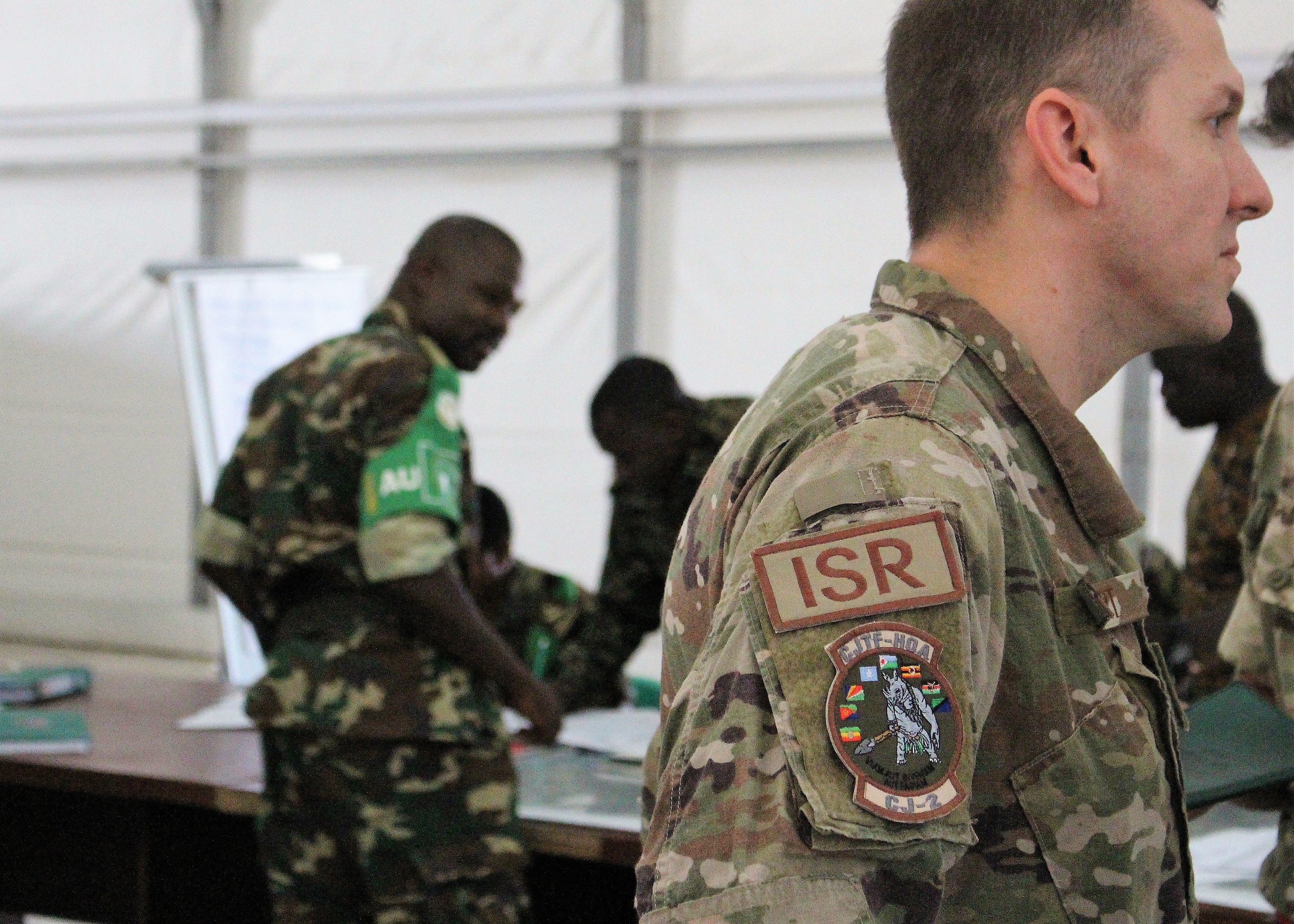 U.S. Air Force Capt. Brian Hurt, Combined Joint Task Force-Horn of Africa, Intelligence Directorate collection manager, advises and assist during an intelligence, surveillance and reconnaissance (ISR) course in Mogadishu, Somalia, Aug. 7, 2017. Soldiers from five countries supporting African Union Mission in Somalia are taking the British led ISR course to strengthen efforts countering regional violent extremist organizations within the region. (Photo courtesy U.S. Air Force Capt. Brian Hurt/Released)