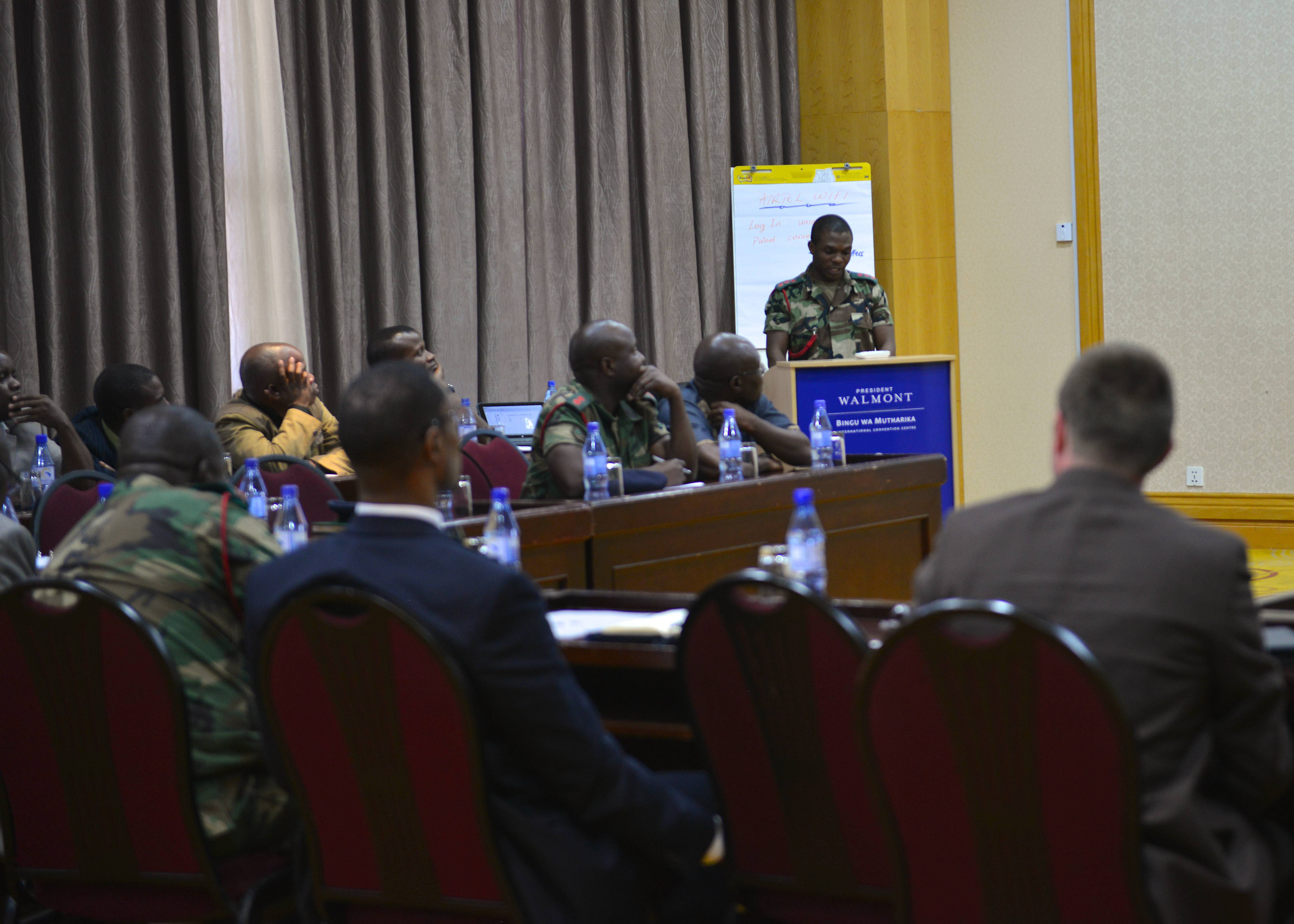 (Aug. 17, 2017) ñ Capt. K. Mlelemba, Malawi Defense Force (MDF) Public Information Officer, addresses both members of the MDF and U.S. Africa Command during a plannerís meeting in support of Africa Endeavor 2017 at the Umodzi Convention Center in Lilongwe, Malawi. Africa Endeavor is an annual senior leader and communications symposium and technology expo designed to develop standardized, multinational communications practices for peacekeeping and disaster response missions mandated by the African Union and the United Nations.