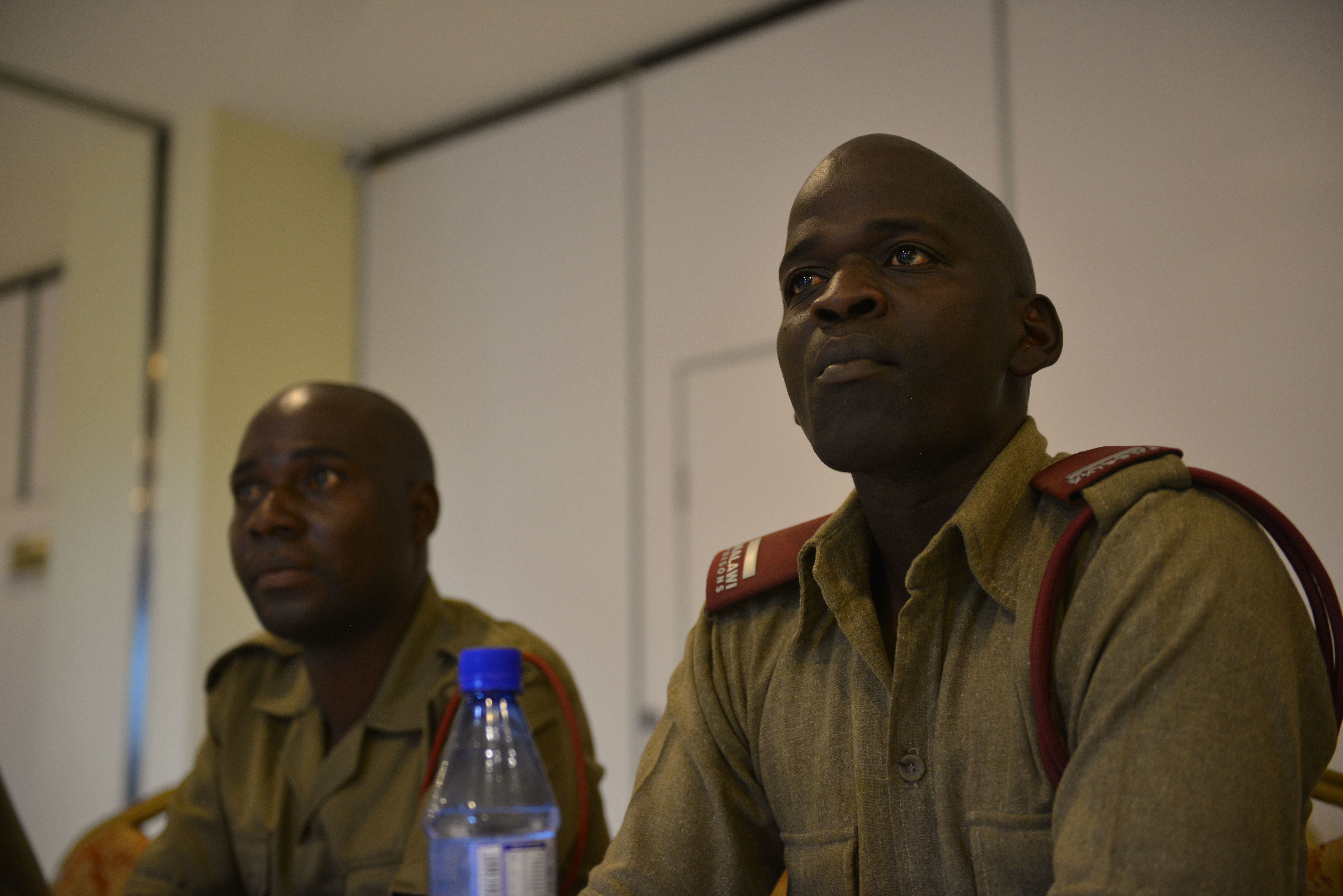 (Aug. 18, 2017) – Steve Meke, Malawi Prison Service Subinspector, attends a briefing during a three-day public affairs exchange between public affairs professionals from Malawi's security sector and members of U.S. Africa Command's public affairs team as part of Africa Endeavor 2017 at the Umodzi Convention Center in Lilongwe, Malawi. Africa Endeavor is an annual senior leader and communications symposium and technology expo designed to develop standardized, multinational communications practices for peacekeeping and disaster response missions mandated by the African Union and the United Nations.(RELEASED)