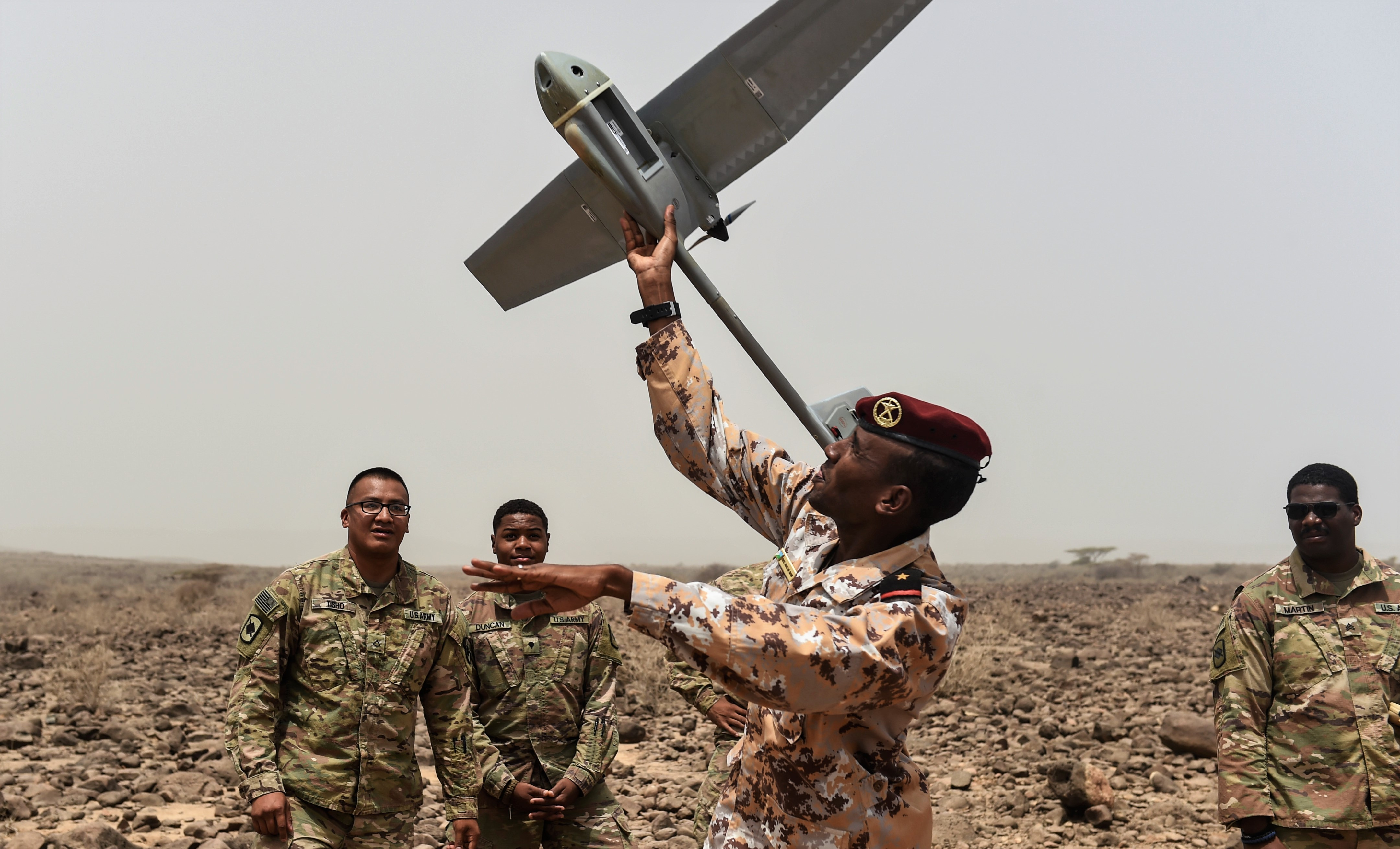 Djibouti Armed Forces Lt. Idriss Abdallah Daoud prepares to hand launch a RQ-11 Raven remotely piloted aircraft during a demonstration in an airfield in southern Djibouti, Aug. 21, 2017. U.S. Army Soldiers of the 1st Battalion, 153rd Infantry Regiment, Task Force Warrior, an associated unit of Combined Joint Task Force - Horn of Africa, gave the demonstration in an effort to help the Djibouti Armed Forces determine if the Raven might benefit FAD operations, helping to maintain stability and security in and around Djibouti. (U.S. Air Force photo by Staff Sgt. Eboni Prince)