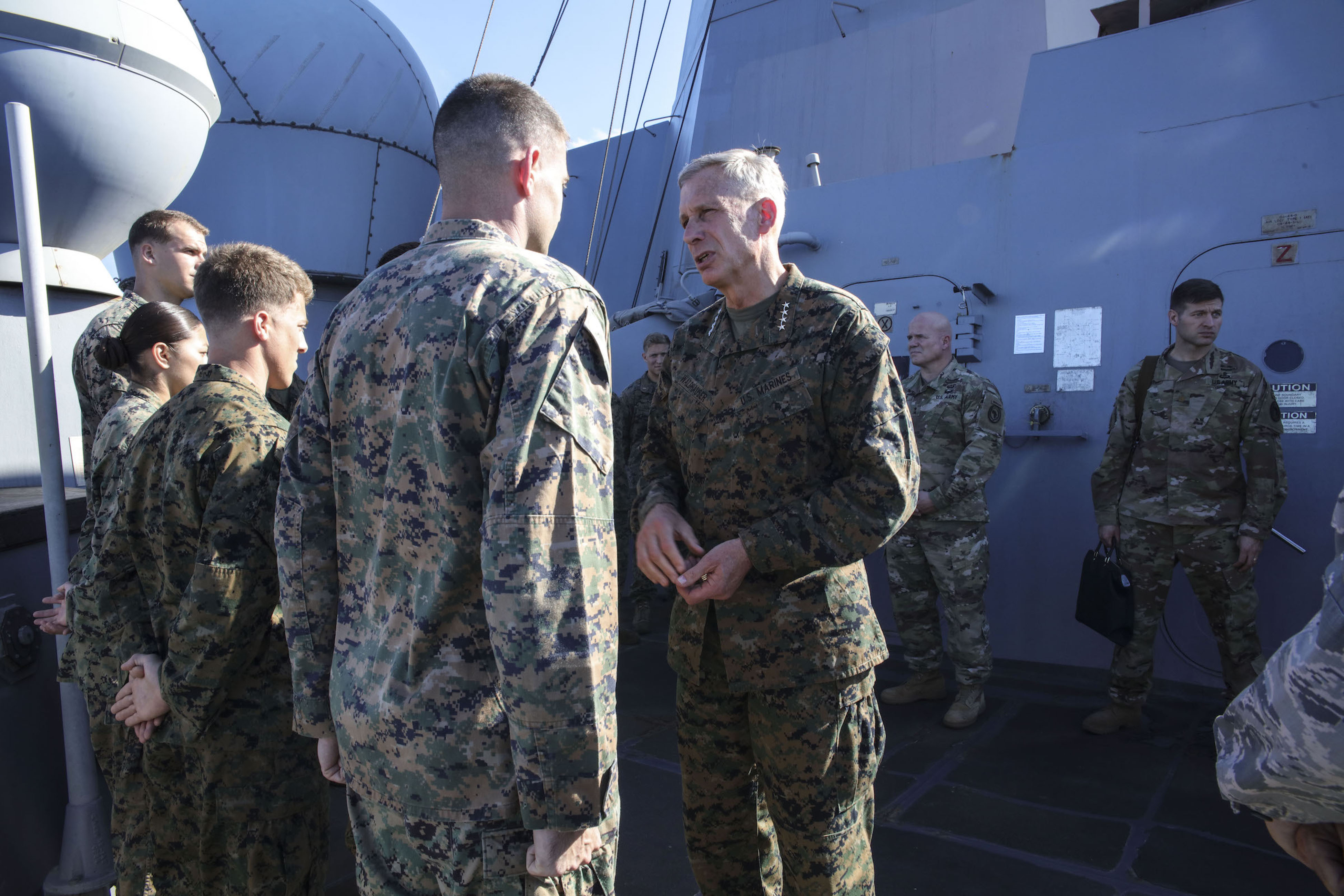 MEDITERRANEAN SEA (Sept. 6, 2017) U.S. Marine Gen. Thomas D. Waldhauser, commander, U.S. Africa Command, speaks with Sailors and Marines aboard the San Antonio-class amphibious transport dock ship USS Mesa Verde (LPD 19) during a visit Sept. 6, 2017. The ship is deployed with the Bataan Amphibious Ready Group and 24th Marine Expeditionary Unit to support maritime security operations and theater security cooperation efforts in the U.S. 6th Fleet area of operations. (U.S. Navy photo by Mass Communication Specialist 2nd Class Brent Pyfrom/Released)