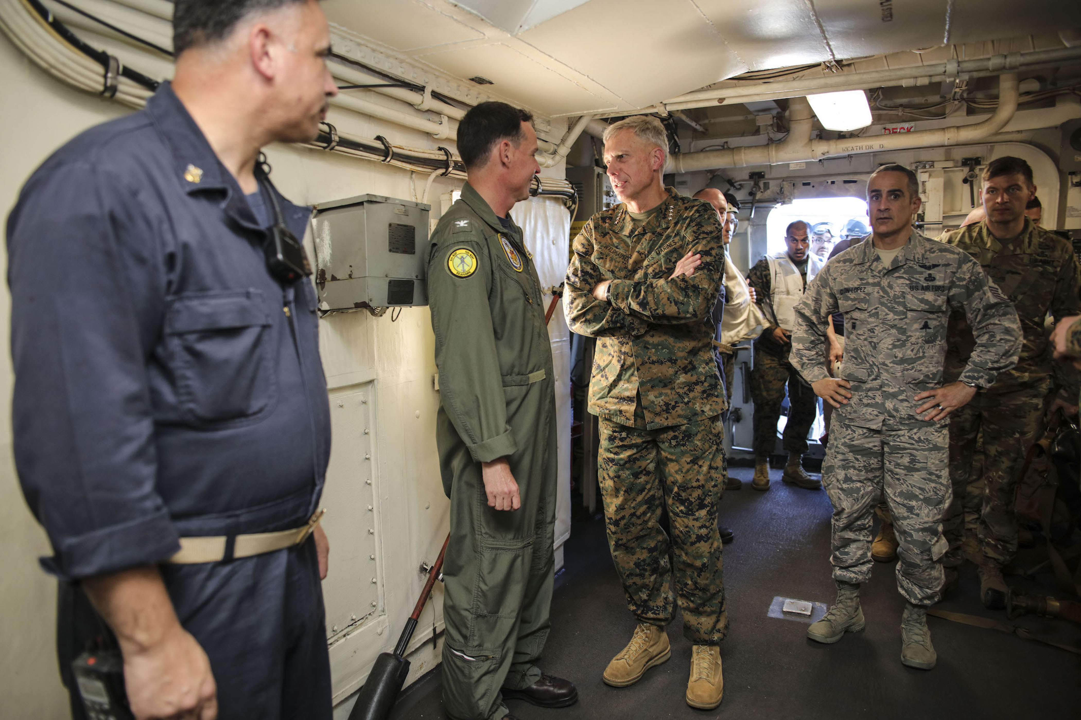 MEDITERRANEAN SEA (Sept. 6, 2017) U.S. Marine Gen. Thomas D. Waldhauser, commander, U.S. Africa Command, middle, speaks with Capt. Max Clark, commanding officer of the San Antonio-class amphibious transport dock ship USS Mesa Verde (LPD 19), during a visit aboard the ship Sept. 6, 2017. The ship is deployed with the Bataan Amphibious Ready Group and 24th Marine Expeditionary Unit to support maritime security operations and theater security cooperation efforts in the U.S. 6th Fleet area of operations. (U.S. Navy photo by Mass Communication Specialist 2nd Class Brent Pyfrom/Released)