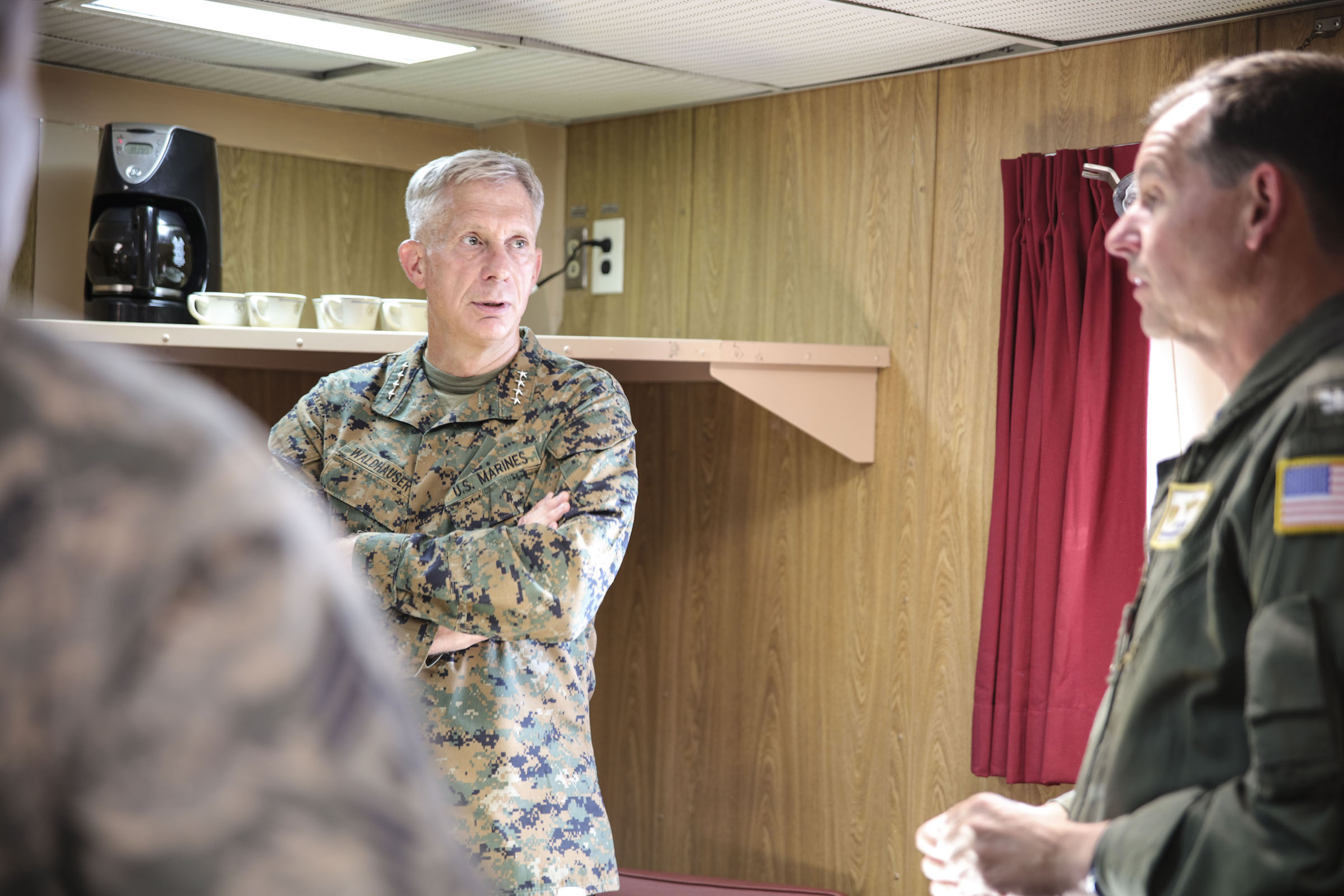 MEDITERRANEAN SEA (Sept. 6, 2017) U.S. Marine Gen. Thomas D. Waldhauser, commander, U.S. Africa Command, left, speaks with Capt. Max Clark, commanding officer of the San Antonio-class amphibious transport dock ship USS Mesa Verde (LPD 19) about maritime operations during a visit Sept. 6, 2017. The ship is deployed with the Bataan Amphibious Ready Group and 24th Marine Expeditionary Unit to support maritime security operations and theater security cooperation efforts in the U.S. 6th Fleet area of operations. (U.S. Navy photo by Mass Communication Specialist 2nd Class Brent Pyfrom/Released)