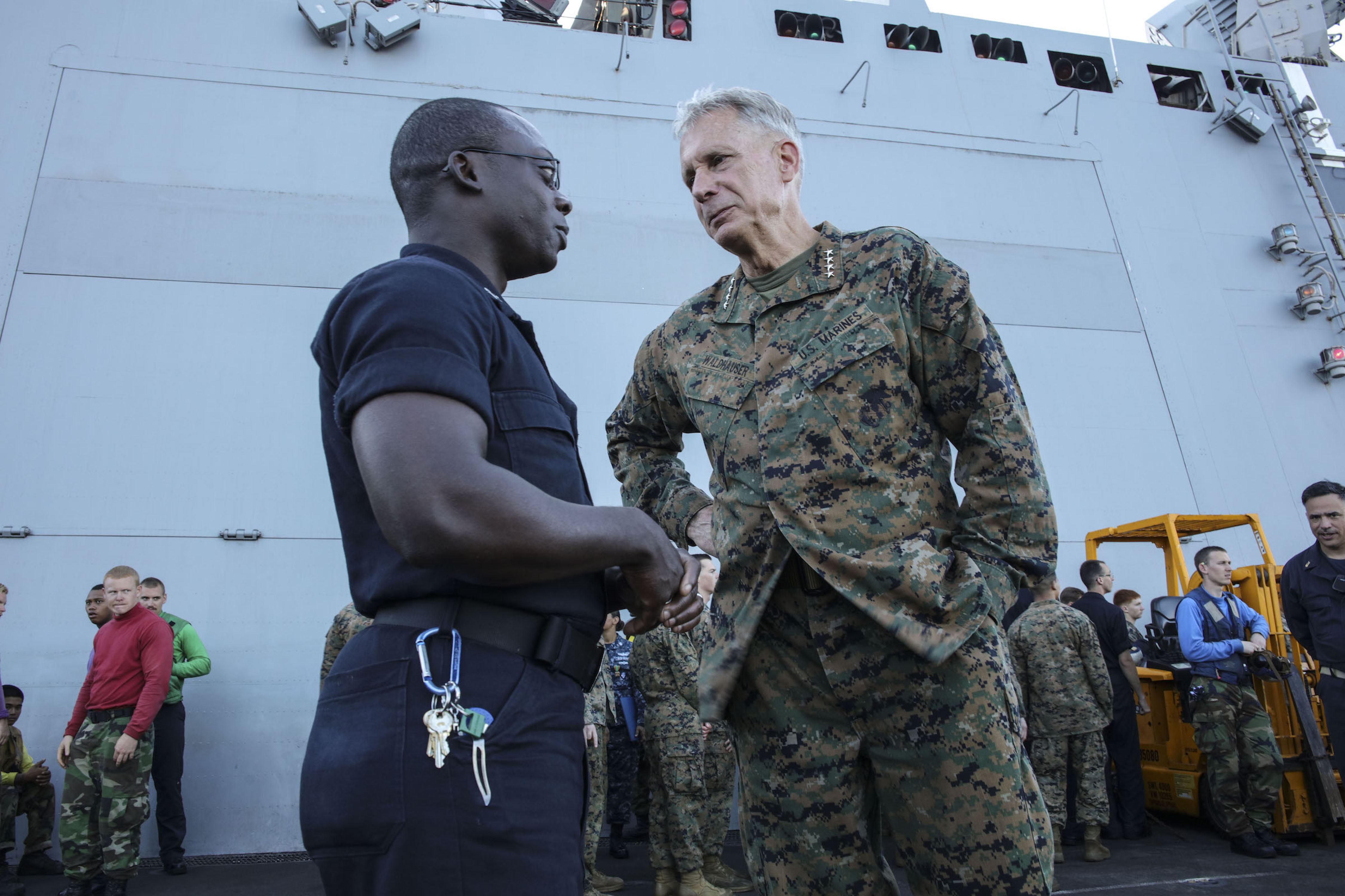 MEDITERRANEAN SEA (Sept. 6, 2017) U.S. Marine Gen. Thomas D. Waldhauser, commander, U.S. Africa Command, speaks with Hospital Corpsman 2nd Class Darren Parker aboard the San Antonio-class amphibious transport dock ship USS Mesa Verde (LPD 19) Sept. 6, 2017. The ship is deployed with the Bataan Amphibious Ready Group and 24th Marine Expeditionary Unit to support maritime security operations and theater security cooperation efforts in the U.S. 6th Fleet area of operations. (U.S. Navy photo by Mass Communication Specialist 2nd Class Brent Pyfrom/Released)