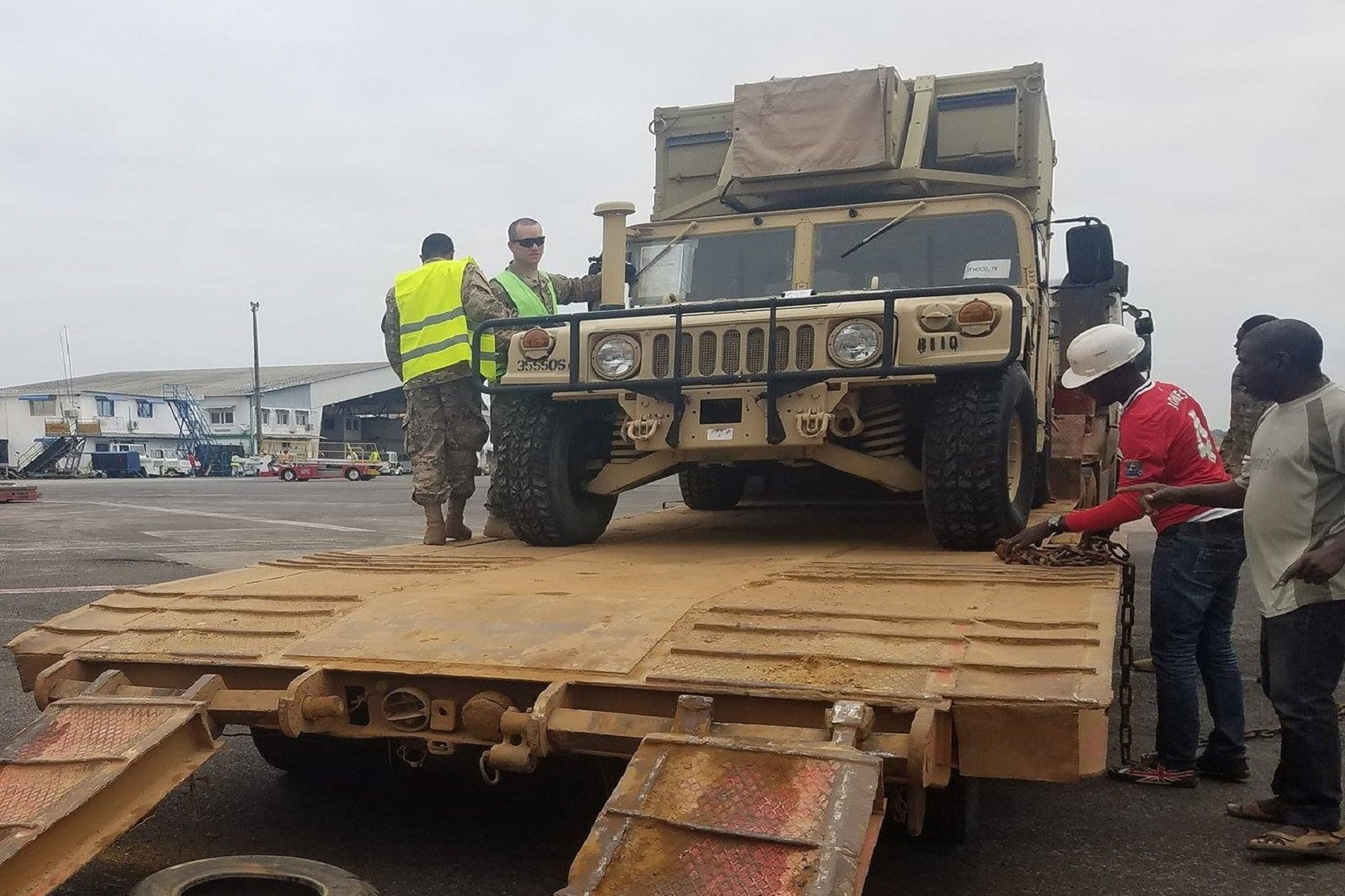 383rd Movement Control Team's Sgt. Scott Hammon inspects a High Mobility Multipurpose Wheeled Vehicle before it departs an African flight-line.  The 383rd MCT is the first MCT assigned to USARAF partnering with French allies and African partners to conduct inspections in Africa before departing on U.S. aircraft. (Photo courtesy of 383rd MCT)