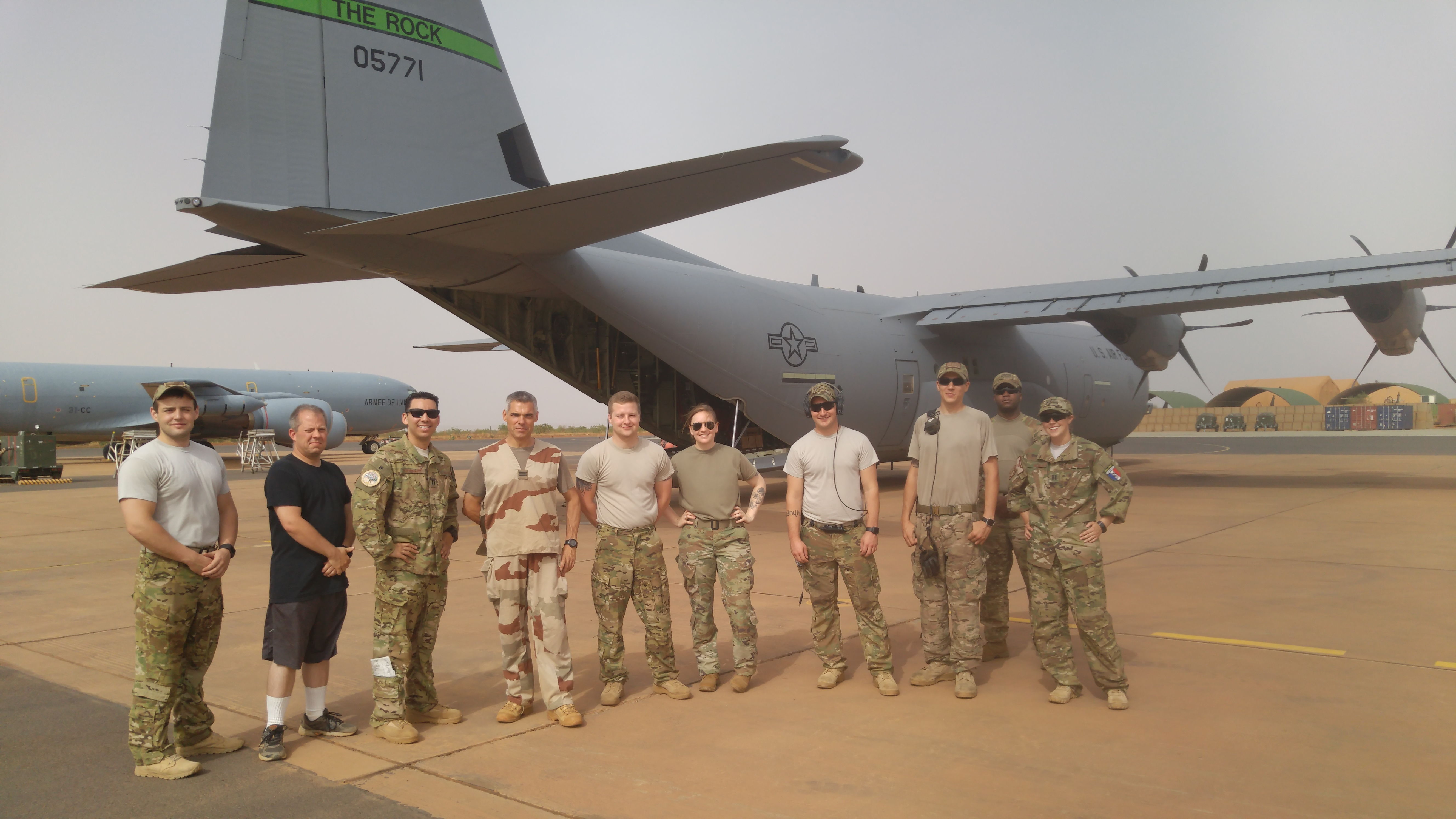 Soldiers from the 383rd Movement Control Team join U.S. Air Force and French allies for a group photo on a Chadian flight-line after working together to ensure cargo is safe and prepared to fly.  The 383rd MCT is the first MCT assigned to USARAF partnering with French allies and African partners to conduct inspections in Africa before departing on U.S. aircraft. (Photo courtesy of 383rd MCT).