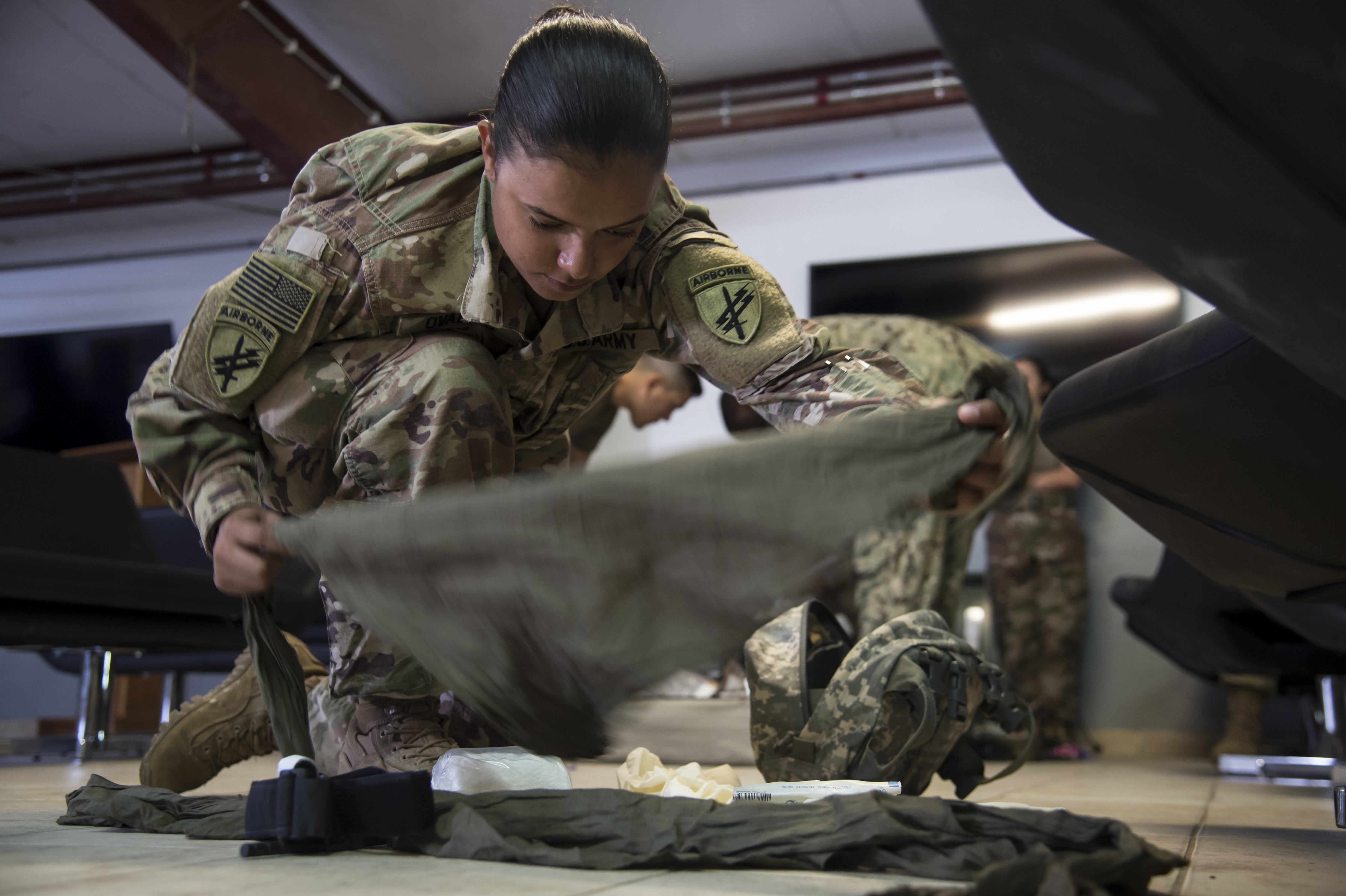 U.S. Army Sgt. Marina Ovalles, Combined Joint Task Force-Horn of Africa supply sergeant, prepares her medical supply kit for the practical application assessment portion of the test to certify in the combat lifesaver course held on Camp Lemonnier, Djibouti, Sept. 15, 2017. The five-day course consists of 40 hours of blended classroom and hands-on training given by certified combat medics, and is open to all military branches here. (U.S. Air National Guard photo by Tech. Sgt. Joe Harwood)