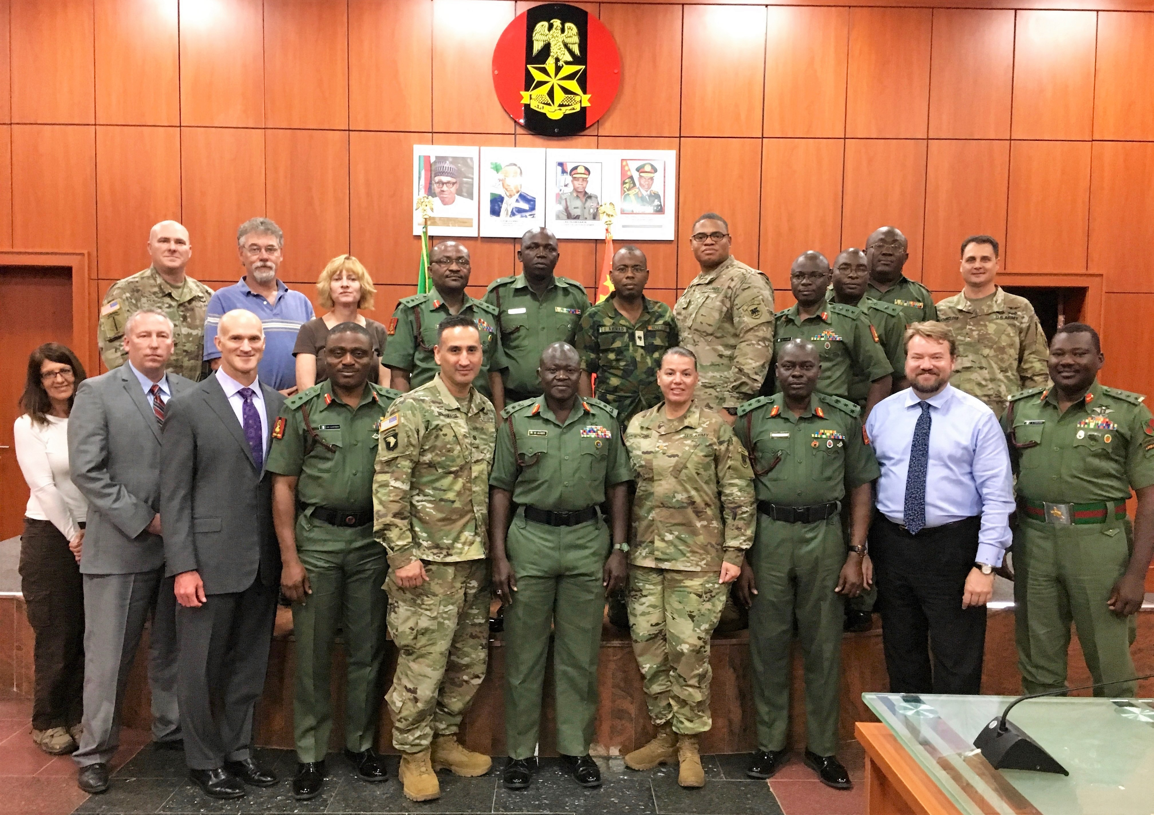 Armed Forces Nigeria and U.S. Army Africa's African Land Forces Summit pose for a group photo in AFN's headquarters in Abuja after introductions and discussion on plans and preparations for next years African Land Forces Summit.  ALFS is a weeklong seminar designed to give African land force's chiefs an opportunity to discuss and develop solutions for improving security and stability in their home country. (Photo by Capt. James Sheehan)