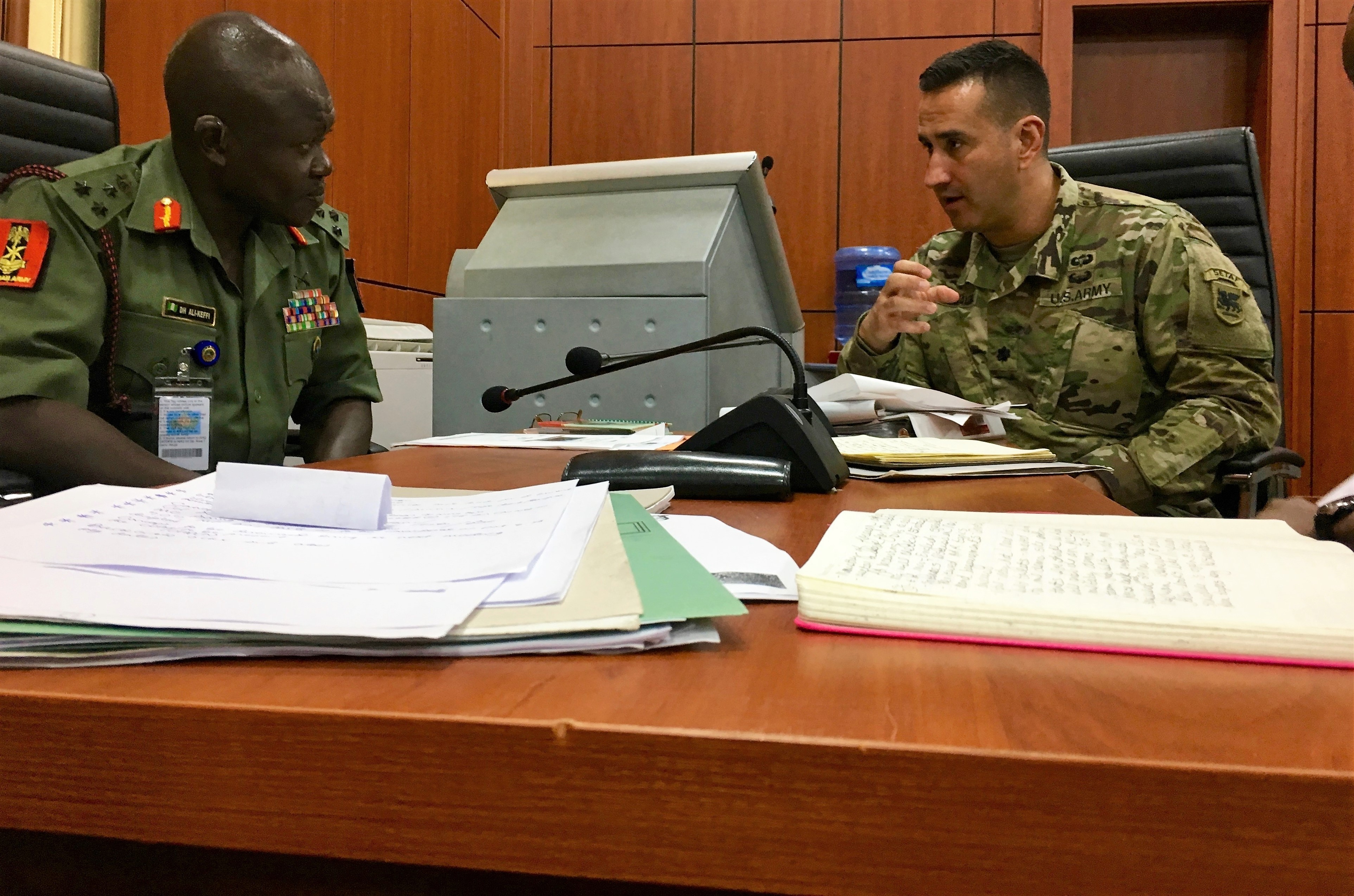 Armed Forces Nigeria and U.S. Army Africa's African Land Forces Summit planning team work together on plans and preparations for next years African Land Forces Summit.  ALFS is a weeklong seminar designed to give African land force's chiefs an opportunity to discuss and develop solutions for improving security and stability in their home country. (Photo by Capt. James Sheehan)