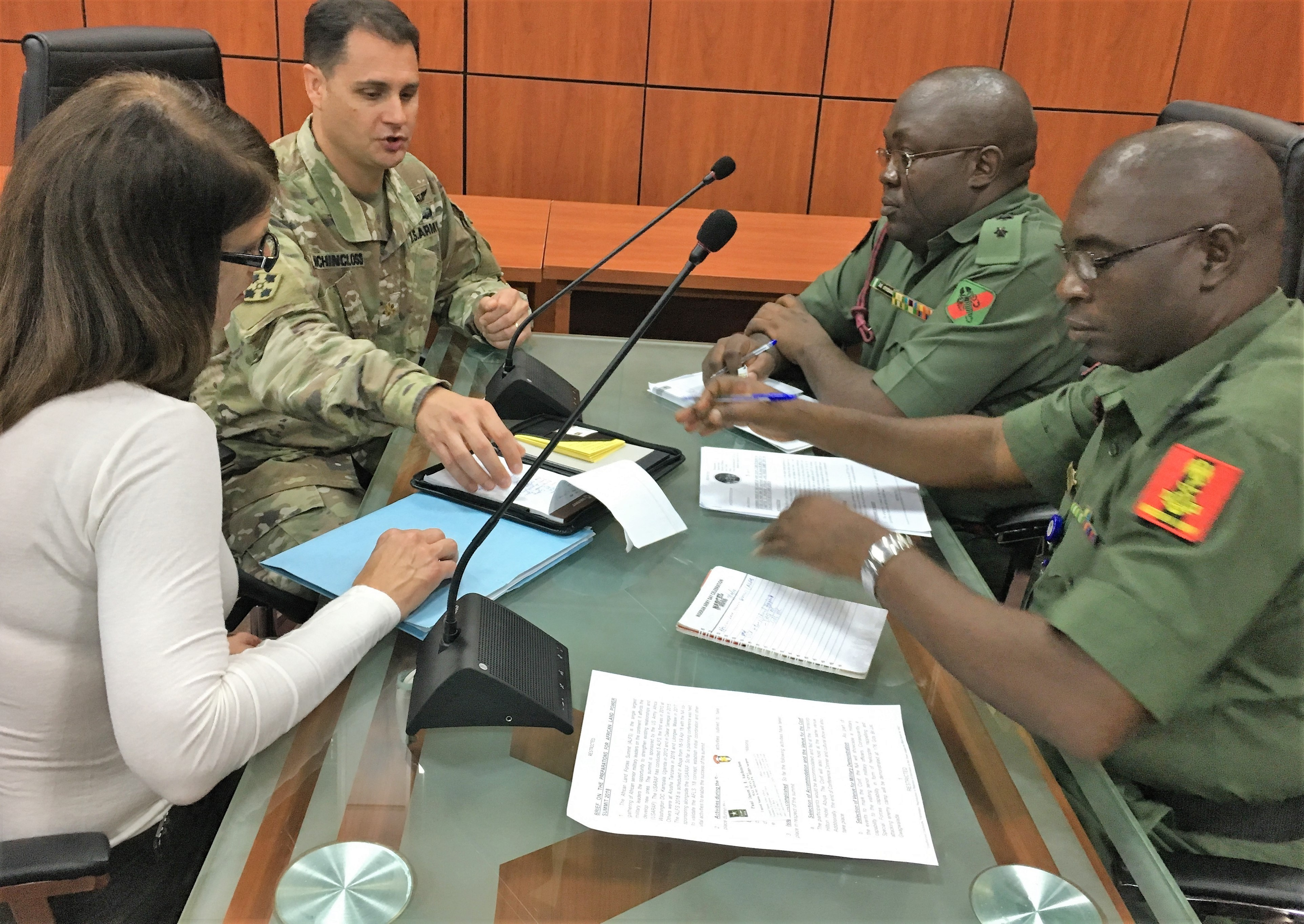 U.S. Army Africa's medical planner Dawn Childs (left), Maj. Jason Auchincloss, Armed Forces Nigeria Lt. Col. Oyebanji and Lt. Col. Ishaku met in Abuja to discuss the medical plan for the upcoming African Land Forces Summit.  ALFS is a weeklong seminar designed to give African land force's chiefs an opportunity to discuss and develop solutions for improving security and stability in their home country. (Photo by Capt. James Sheehan)
