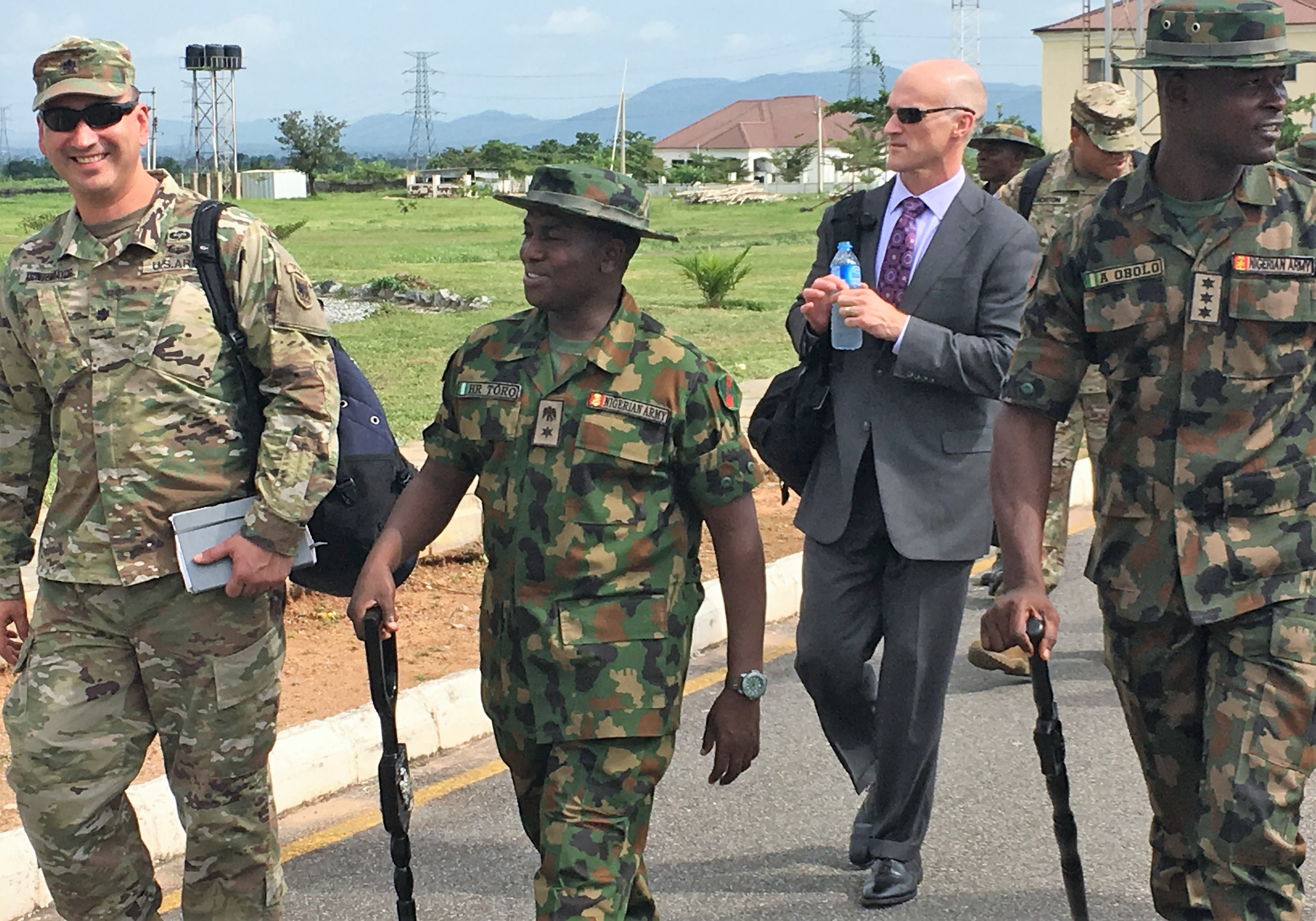 African Land Forces Summit 2018 lead planner, Lt. Col. Hector Montemayor (left) and Lt. Col. Husaini Toro, 176th Guards Battalion commander walk together at the proposed site for the summit's military demonstration in Abuja.  ALFS is a weeklong seminar designed to give African land force's chiefs an opportunity to discuss and develop solutions for improving security and stability in their home country. (Photo by Capt. James Sheehan)
