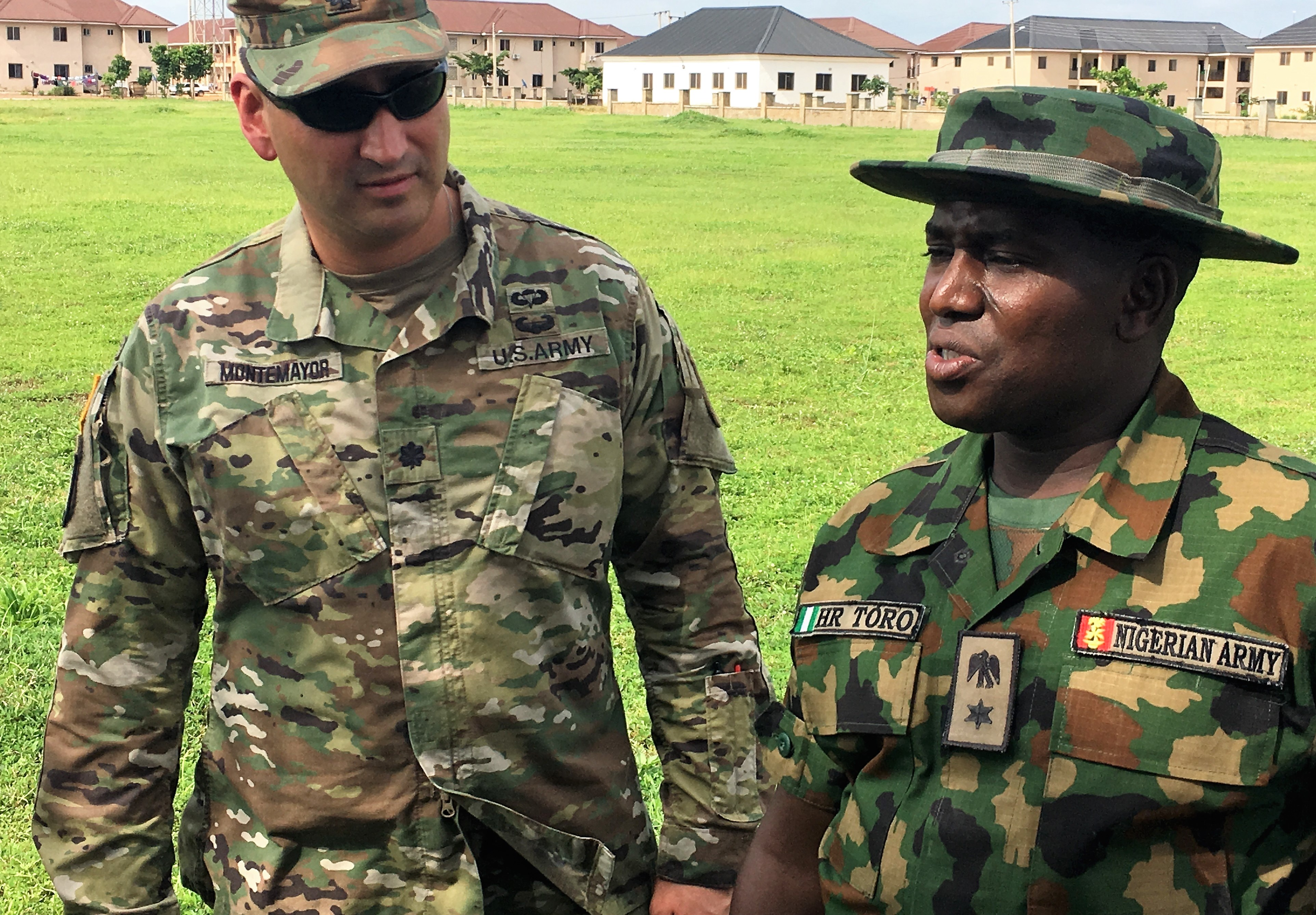 African Land Forces Summit 2018 lead planner, Lt. Col. Hector Montemayor (left) and Lt. Col. Husaini Toro, 176th Guards Battalion commander discuss site options for the summit's military demonstration in Abuja.  ALFS is a weeklong seminar designed to give African land force's chiefs an opportunity to discuss and develop solutions for improving security and stability in their home country. (Photo by Capt. James Sheehan)