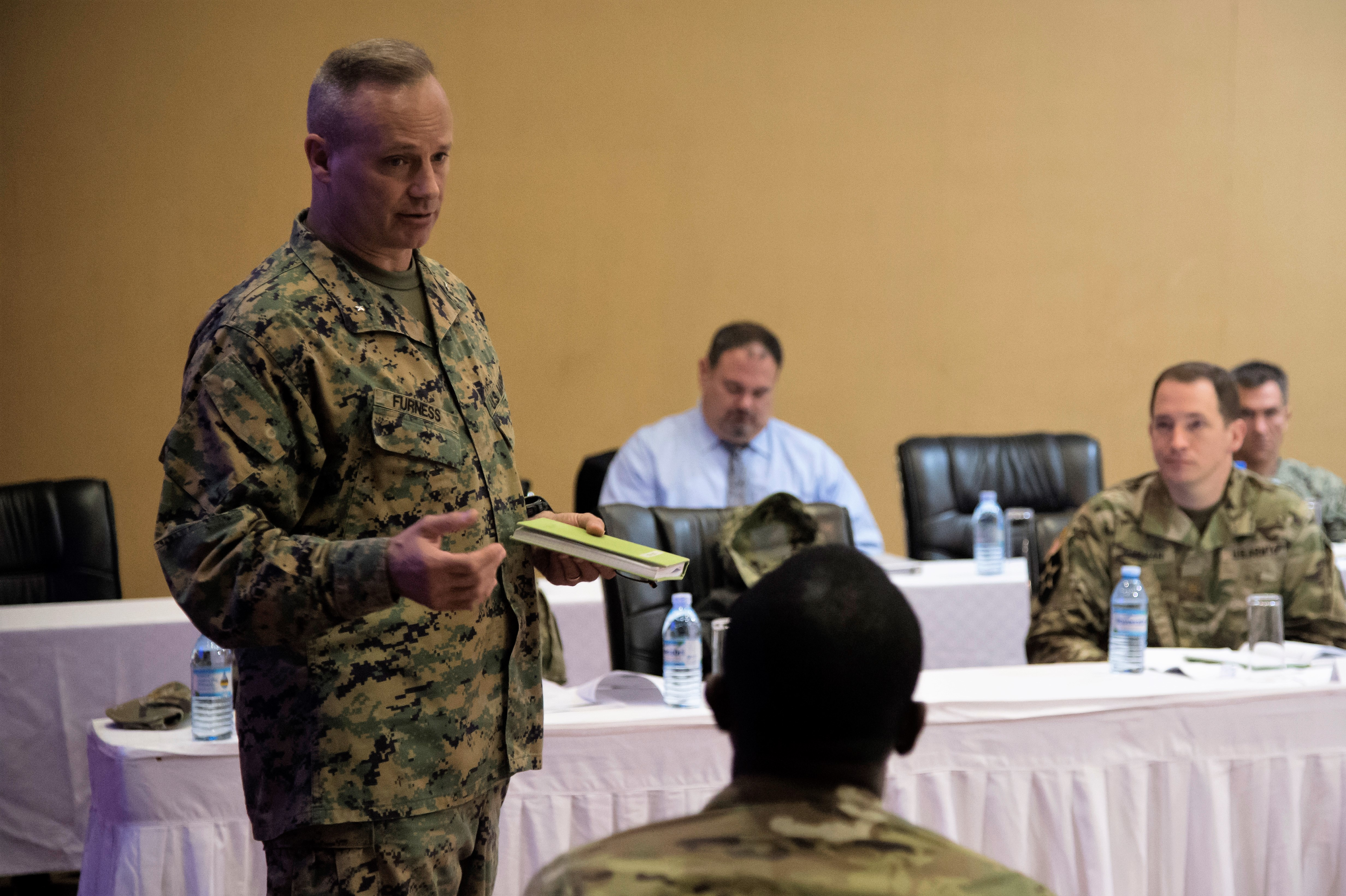Combined Joint Task Force-Horn of Africa Commanding General, U.S. Marine Corps Brig. Gen. David Furness, speaks to attendees at the 2017 East African Senior Defense Official/Defense Attaché Conference in Kampala, Uganda, to discuss regional issues of East Africa and address threat mitigation options to counter improvised explosive devices, Oct. 17, 2017. Subject matter experts from a variety of government agencies discussed military partnership opportunities to enhance security and stability throughout East Africa. (U.S. Air National Guard photo by Tech. Sgt. Joe Harwood)