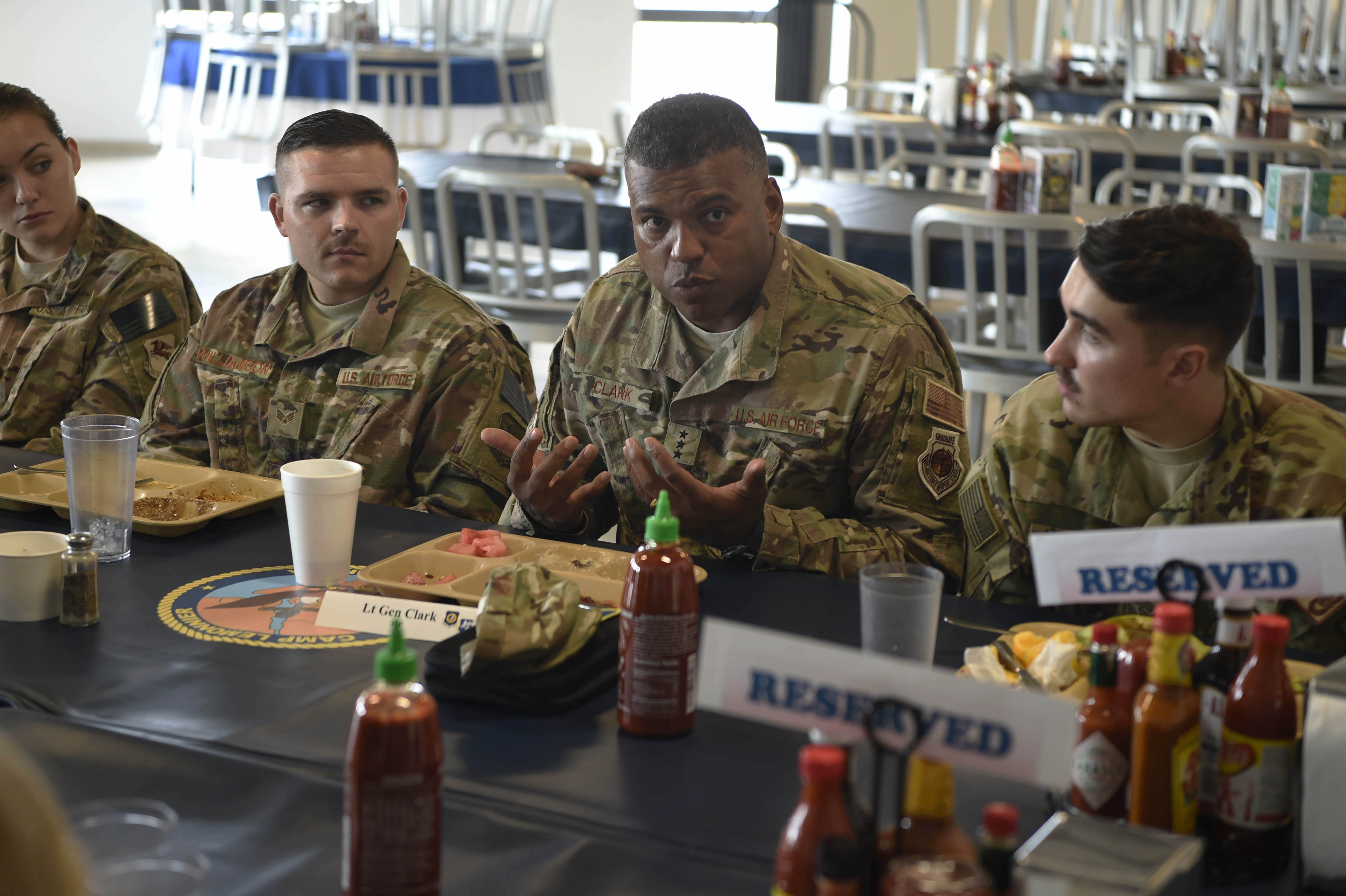 U. S. Air Force Lt. Gen. Richard Clark, 3rd Air Force/17th Expeditionary AF commander, eats breakfast with Airmen from the 449th Air Expeditionary Group at Combined Joint Task Force - Horn of Africa, Djibouti, on Oct. 17, 2017. Clark visited Airmen from around the 435th Air Expeditionary Wing deployed throughout Africa to spend time with Airmen and answer their questions. (U.S. Air Force photo by Staff Sgt. Joshua R. M. Dewberry)