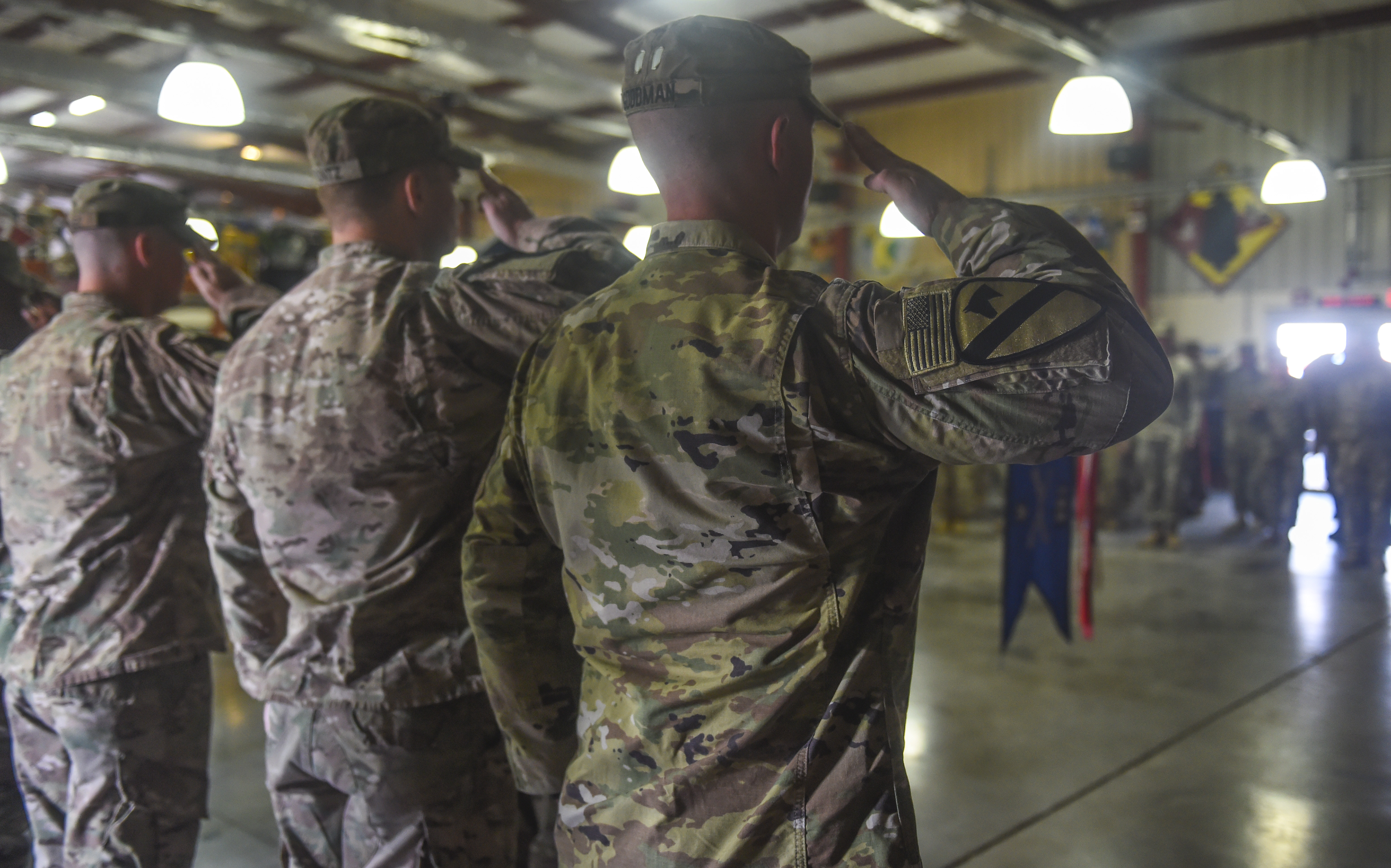 U.S. Army Soldiers assigned to the 1st Battalion, 153rd Infantry Regiment render salutes during a transfer of authority ceremony at Camp Lemonnier, Djibouti, Nov. 1, 2017. During the ceremony, the 1-153rd transferred mission authority to the 3rd Battalion, 144th Infantry Regiment. During their rotation as Task Force Warrior, the 1-153rd IN Soldiers provided security force assistance and force protection for U.S. interests and partner nations at Camp Lemonnier and in the Combined Joint Task Force – Horn of Africa's area of responsibility. (U.S. Air Force photo by Staff Sgt. Timothy Moore)