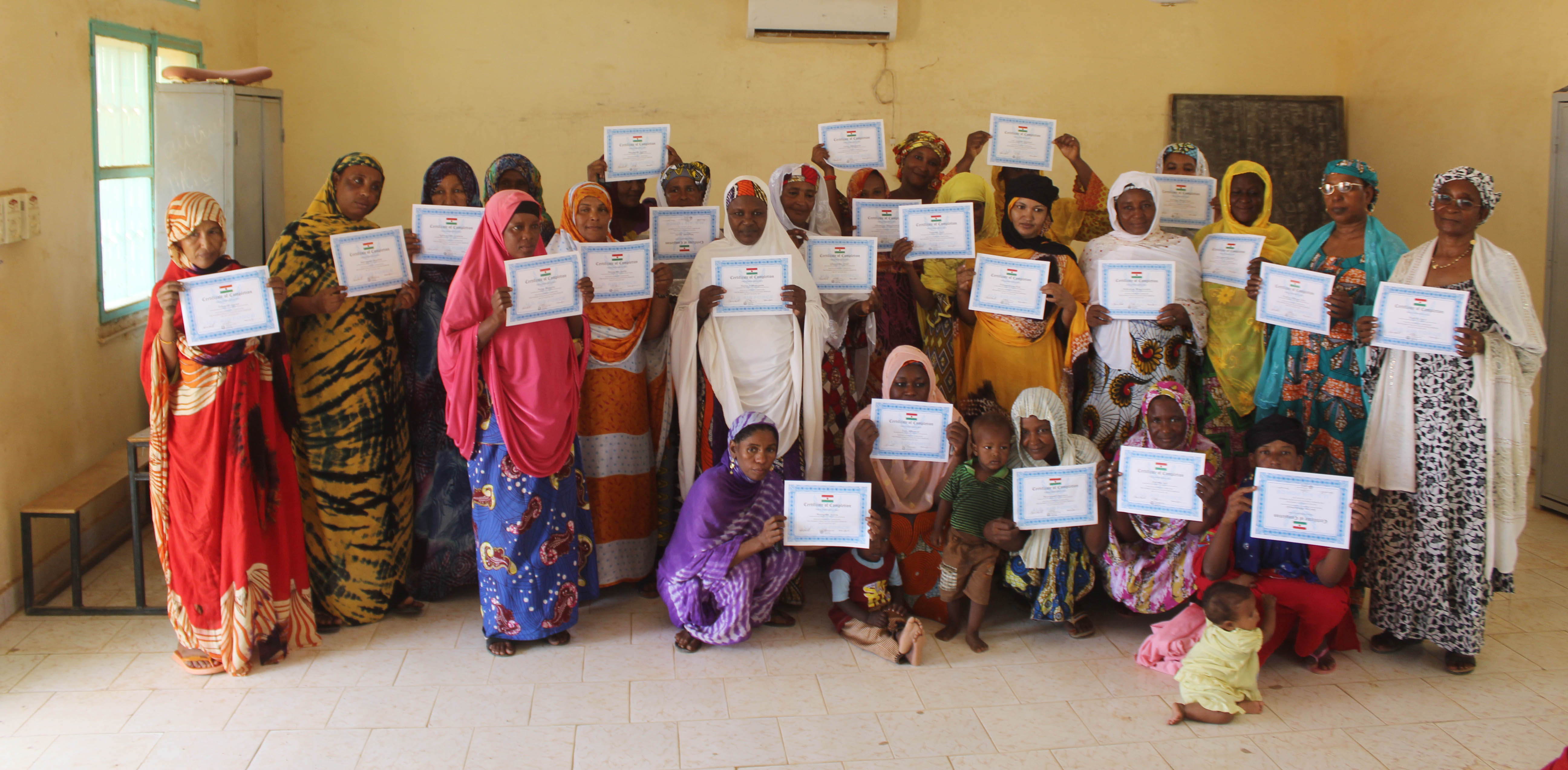 Members of the Association of Nigerien Women Against War pose for a picture with their certificates of completion after a women's hygiene class on Aug. 14, 2017, in Agadez, Niger. The three-day course covered topics such as breast feeding, feminine health and family planning. (Courtesy picture from the 724th Expeditionary Air Base Squadron medical section)