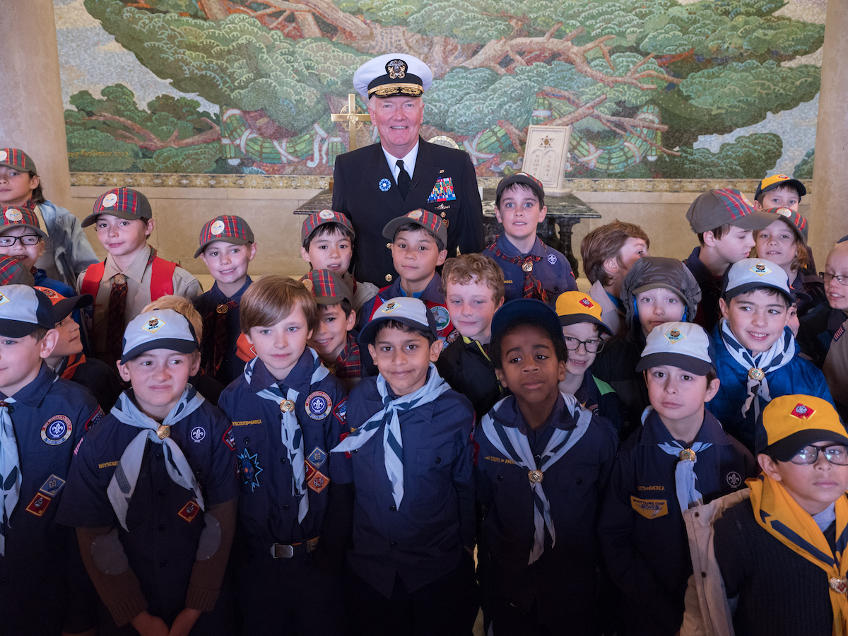 SURESNES, France -- Adm. James Foggo III, commander, U.S. Naval Forces Europe-Africa, poses for a photo with American and French Boy and Girl Scouts during a ceremony at Suresnes American Cemetery celebrating Armistice and Veterans Day Nov. 11, 2017. U.S. Naval Forces Europe-Africa, headquartered in Naples, Italy, oversees joint and naval operations, often in concert with allied and interagency partners, to enable enduring relationships and increase vigilance and resilience in Europe and Africa. (Courtesy photo by Chantal Mistral-Bernard/Released)