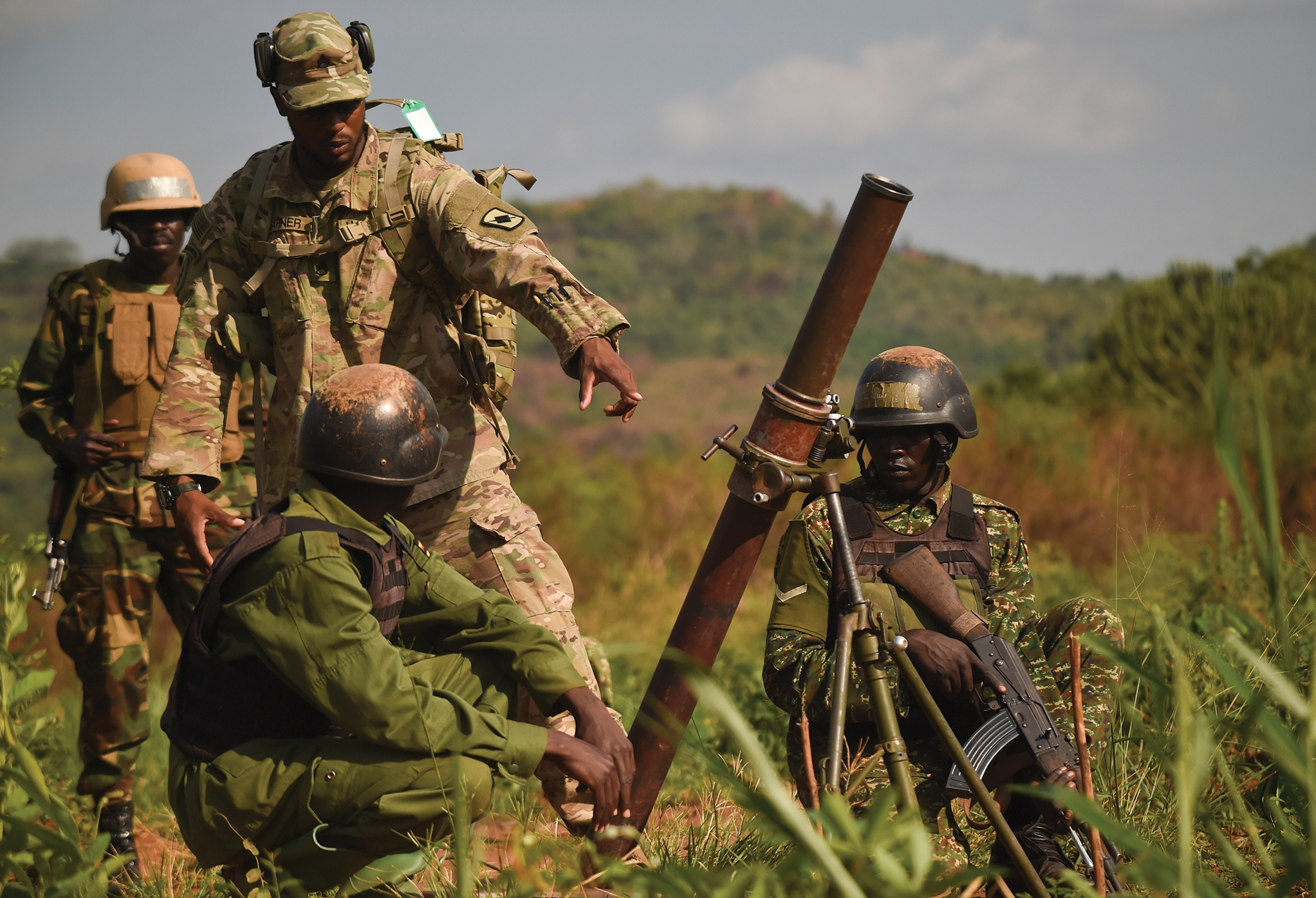 U.S. Army Staff Sgt. John Garner assists Ugandan forces during live-fire mortar training in Uganda