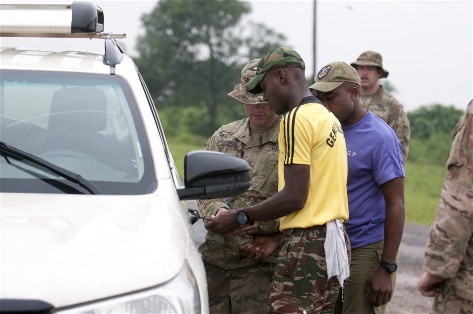 DOUALA, Cameroon -- Army 1st Lt. Jacob Schall, left, a platoon leader for the 764th Ordnance Company from Fort Carson, Colo., instructs Cameroonian troops how to handle vehicle-borne improvised explosive devices during Exercise Counter Improvised Explosive Device-Defeat Phase I in Douala, Cameroon, Nov. 15, 2017. Army photo by Sgt. 1st Class Alexandra Hays