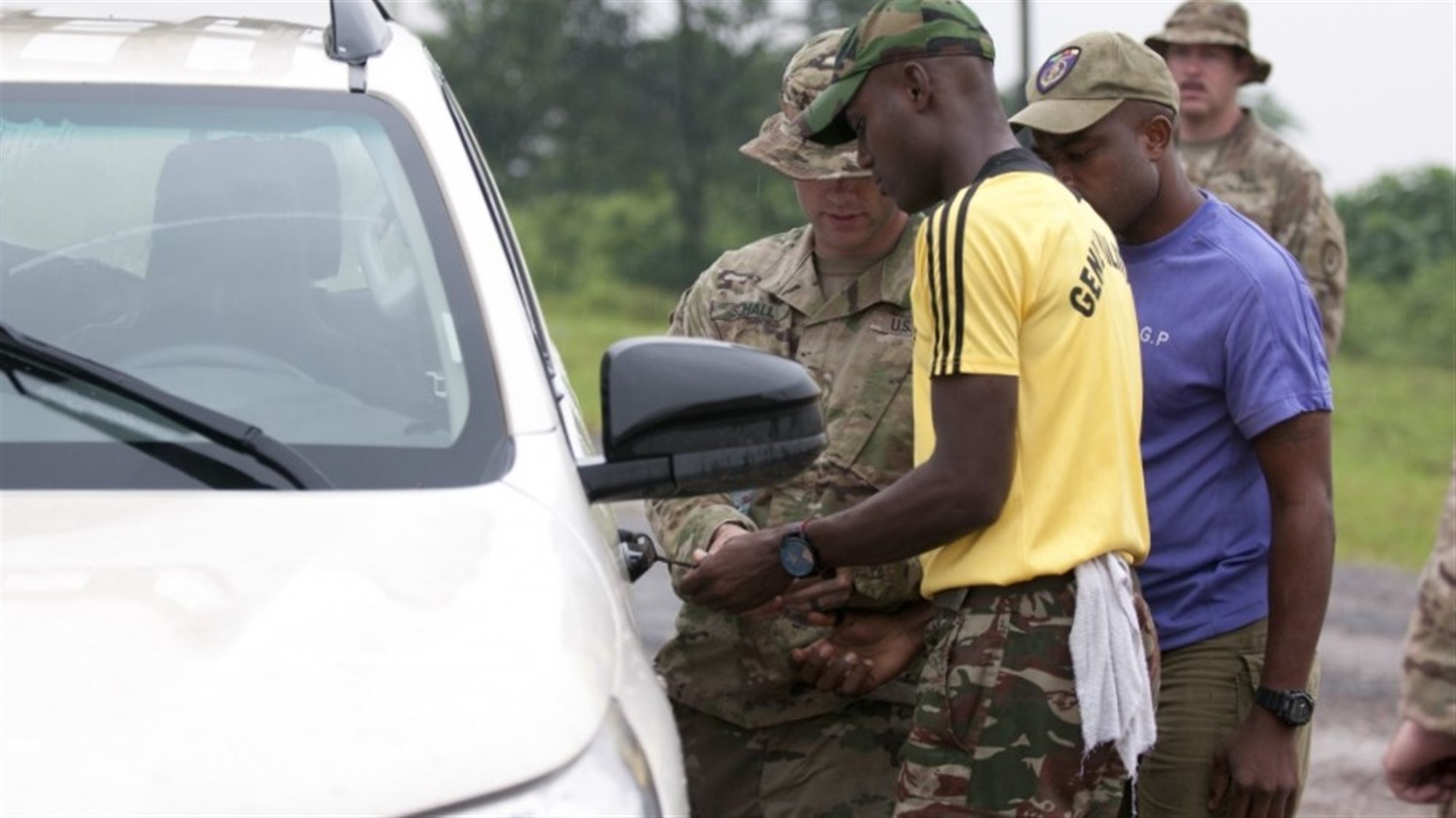 DOUALA, Cameroon --  Army 1st Lt. Jacob Schall, left, a platoon leader for the 764th Ordnance Company from Fort Carson, Colo., instructs Cameroonian troops how to handle vehicle-borne improvised explosive devices during Exercise Counter Improvised Explosive Device-Defeat Phase I in Douala, Cameroon, Nov. 15, 2017.