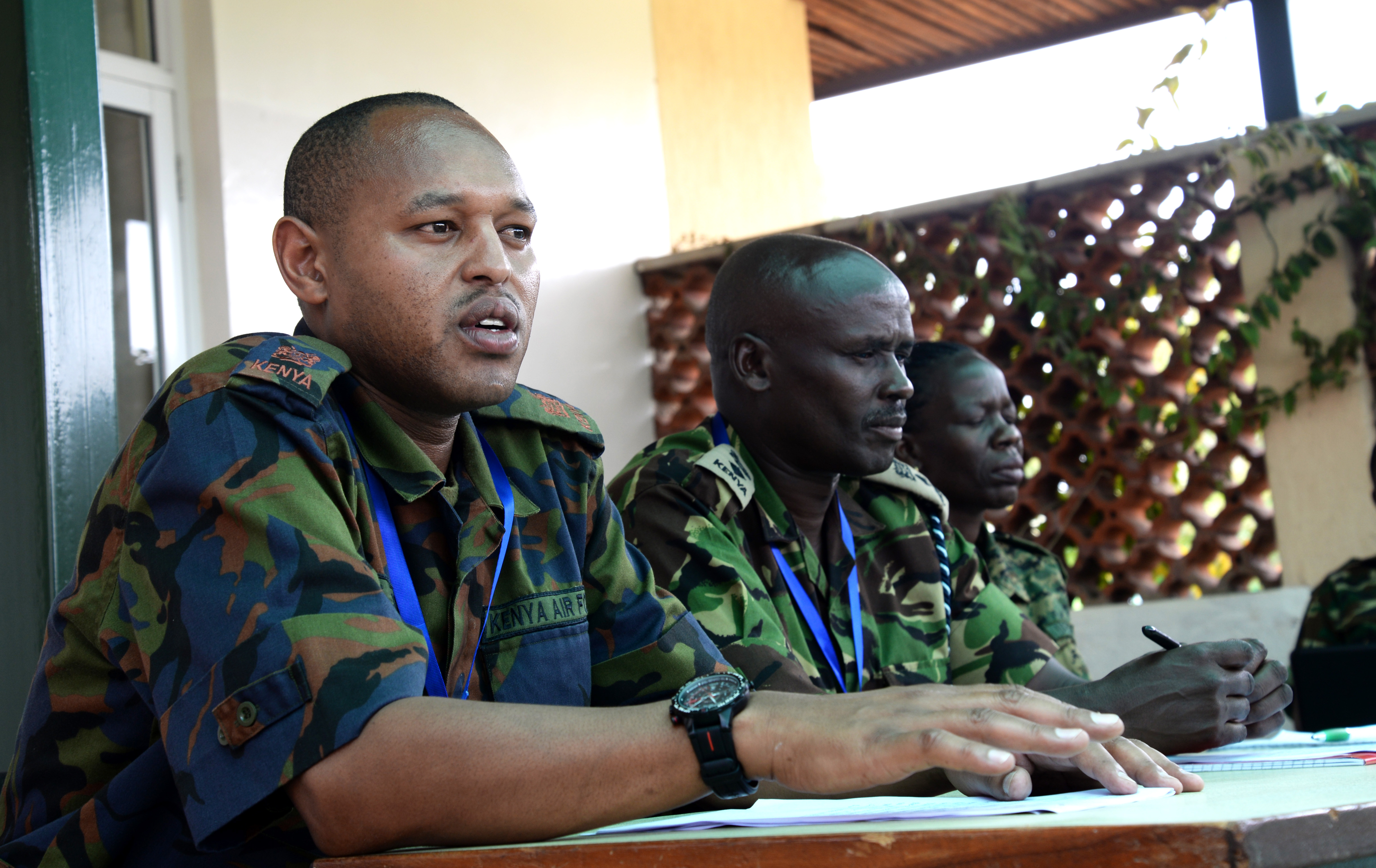 Officers from Kenya, Burundi and Uganda prepare for a simulated press conference March 3, 2016, during an exercise to complete an AMISOM staff officer course in Nairobi, Kenya. The practice press conference tested the public information officers' ability to prepare and present a press conference. (U.S. Air Force photo by Staff Sgt. Kate Thornton)