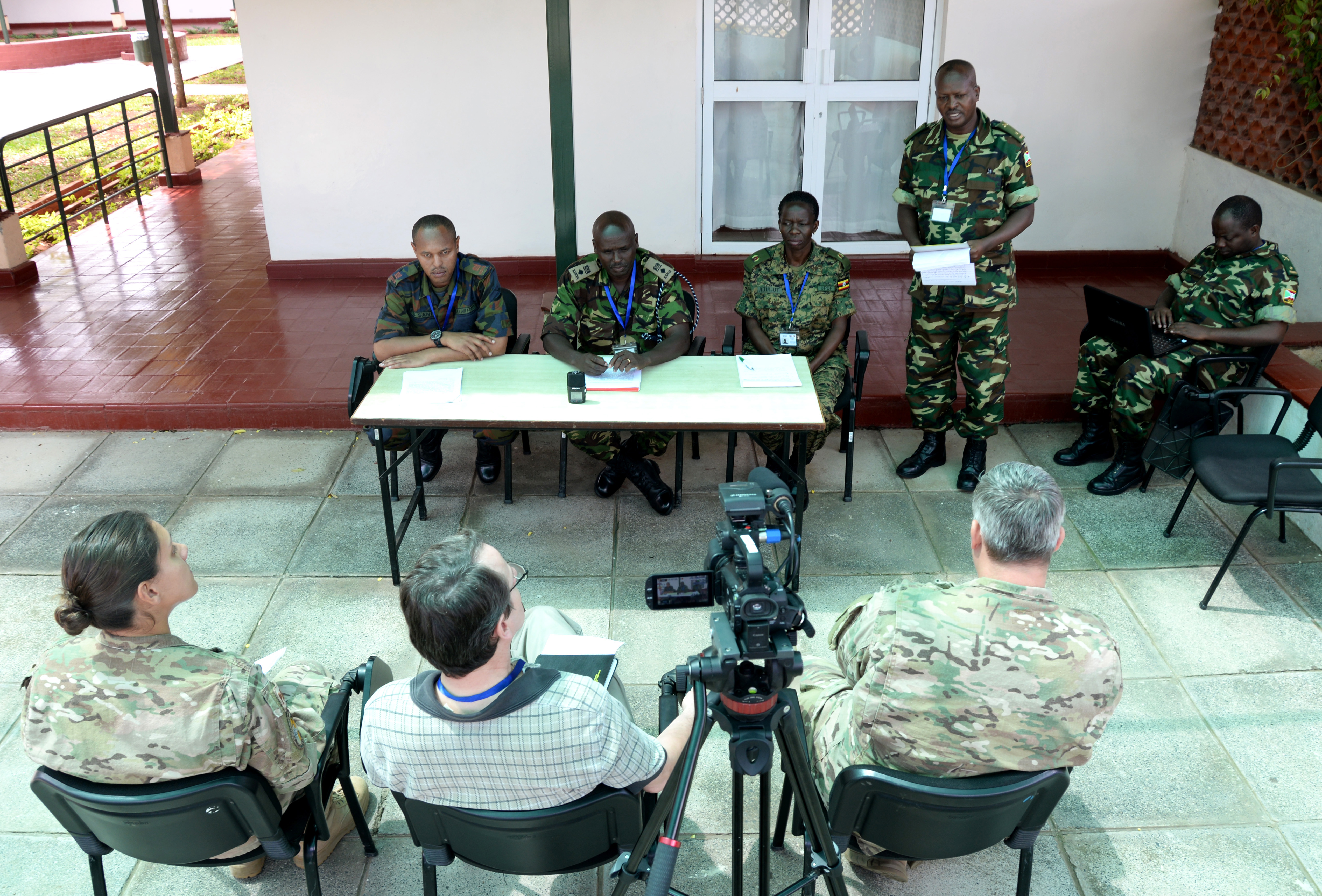 An officer from the Kenya Defence Forces speaks to media at a simulated press conference March 3, 2016, during a course in Nairobi, Kenya to train African Union Mission in Somalia staff officers prior to deployment. The press conference tested the officers' ability to answer questions accurately, confidently and without revealing sensitive military information. (U.S. Air Force photo by Staff Sgt. Kate Thornton)