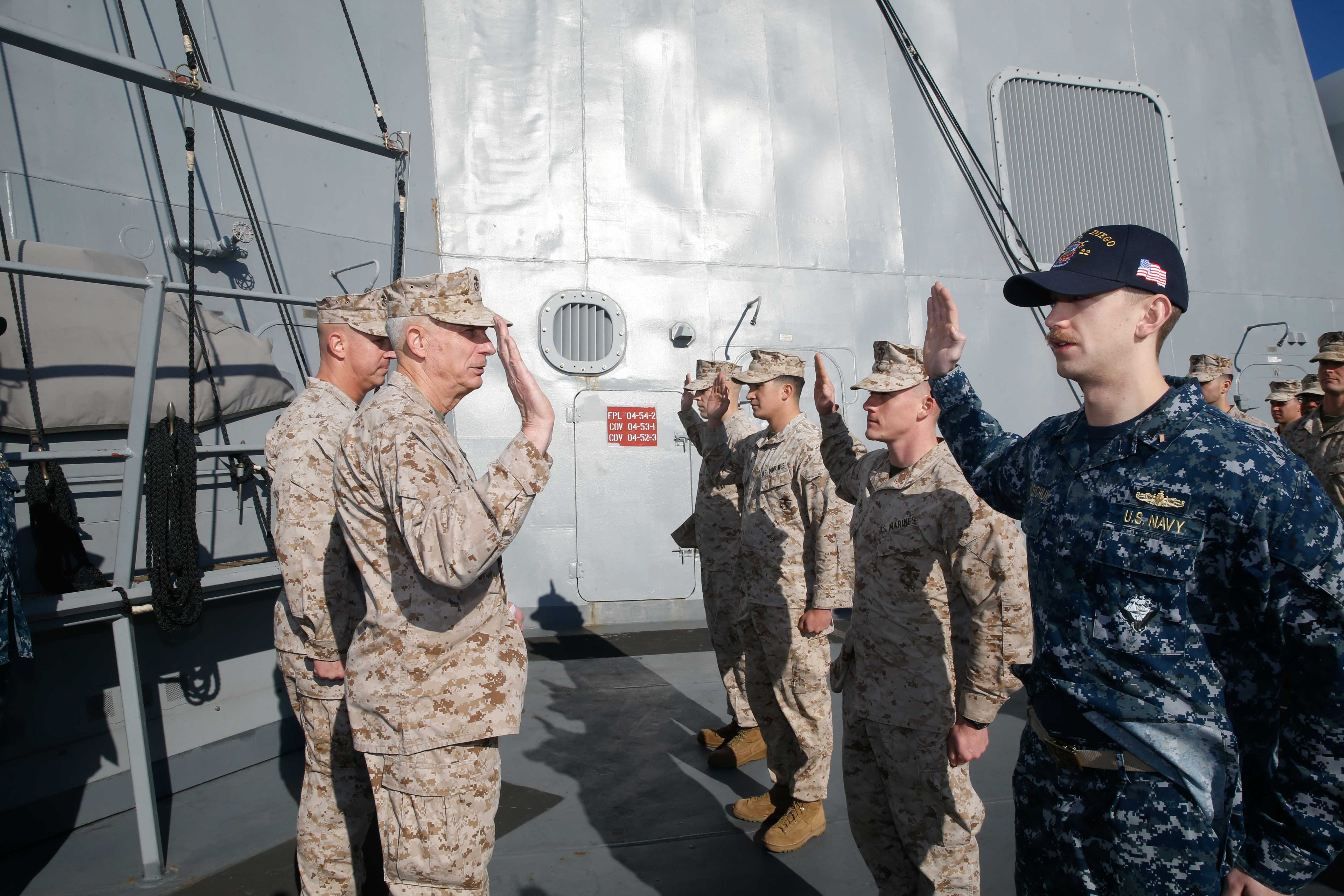 MEDITERRANEAN SEA (Nov. 29, 2017) – U.S. Marine Corps Gen. Thomas D. Waldhauser, Commander, U.S. Africa Command, recites an Oath with Marines and Sailor O3 selects during a promotion ceremony aboard the San Antonio-class amphibious transport dock ship USS San Diego (LPD 22), Nov. 29, 2017. Waldhauser visited the USS San Diego (LPD 22) to personally congratulate Marines and Sailors of the 15th Marine Expeditionary Unit and America Amphibious Ready Group for the work and efforts in supporting missions in the 6th Fleet area of operations. USS San Diego is deployed with the America ARG and 15th MEU to support maritime security operations and theater security cooperation efforts in the U.S. 6th Fleet area of operations.(U.S. Marine Corps photo by Cpl. Jeremy Laboy/Released)