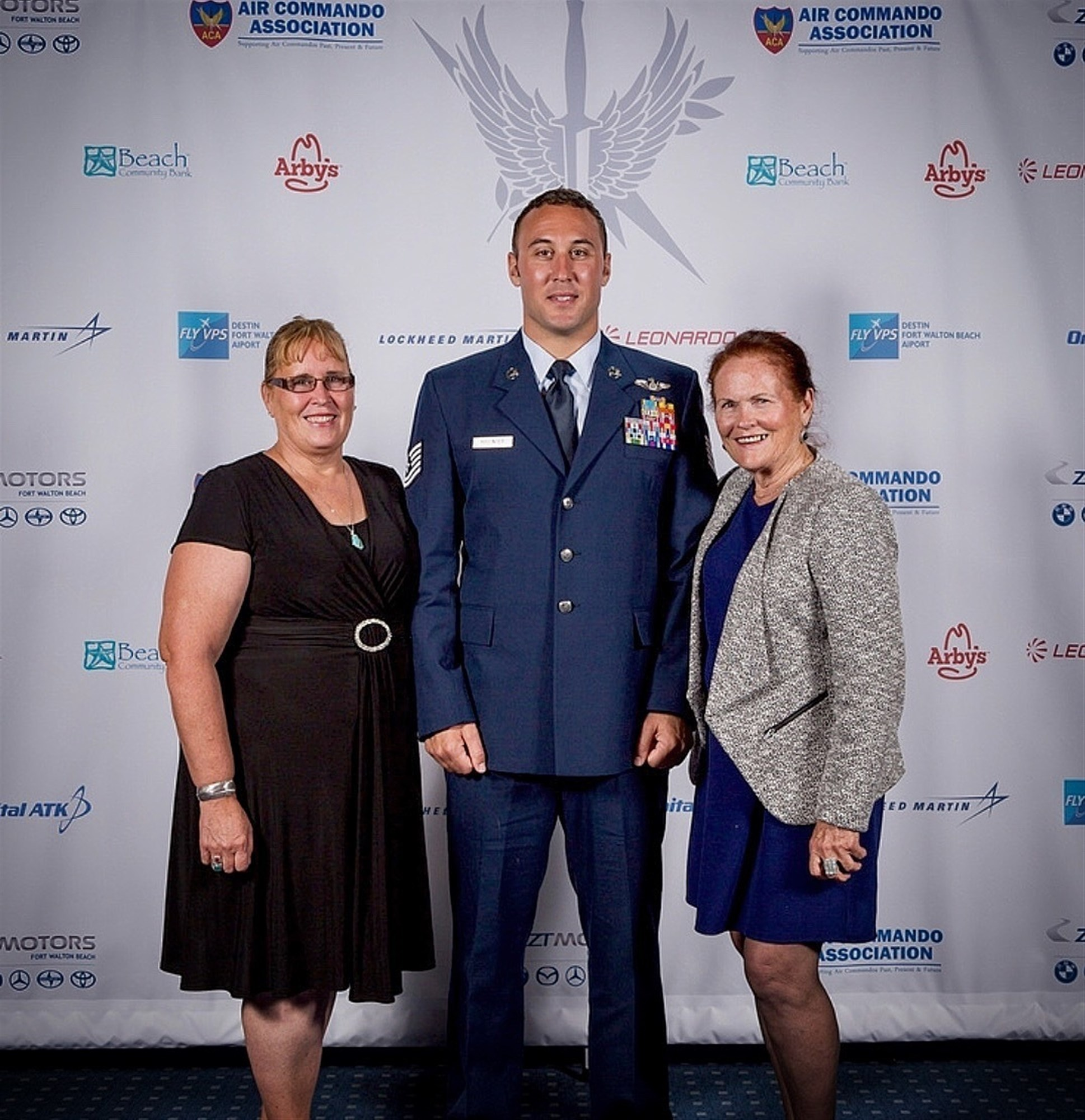 U.S. Air Force Tech. Sgt. Kade Bollinger poses for a photo with his mother and grandmother following his award recognition Oct. 13, 2017, at the Air Commando Association award banquet at Hurlburt Field, Florida. The major command level award is presented to the Airman who provided the greatest contribution to AFSOC in that year. (Courtesy photo)