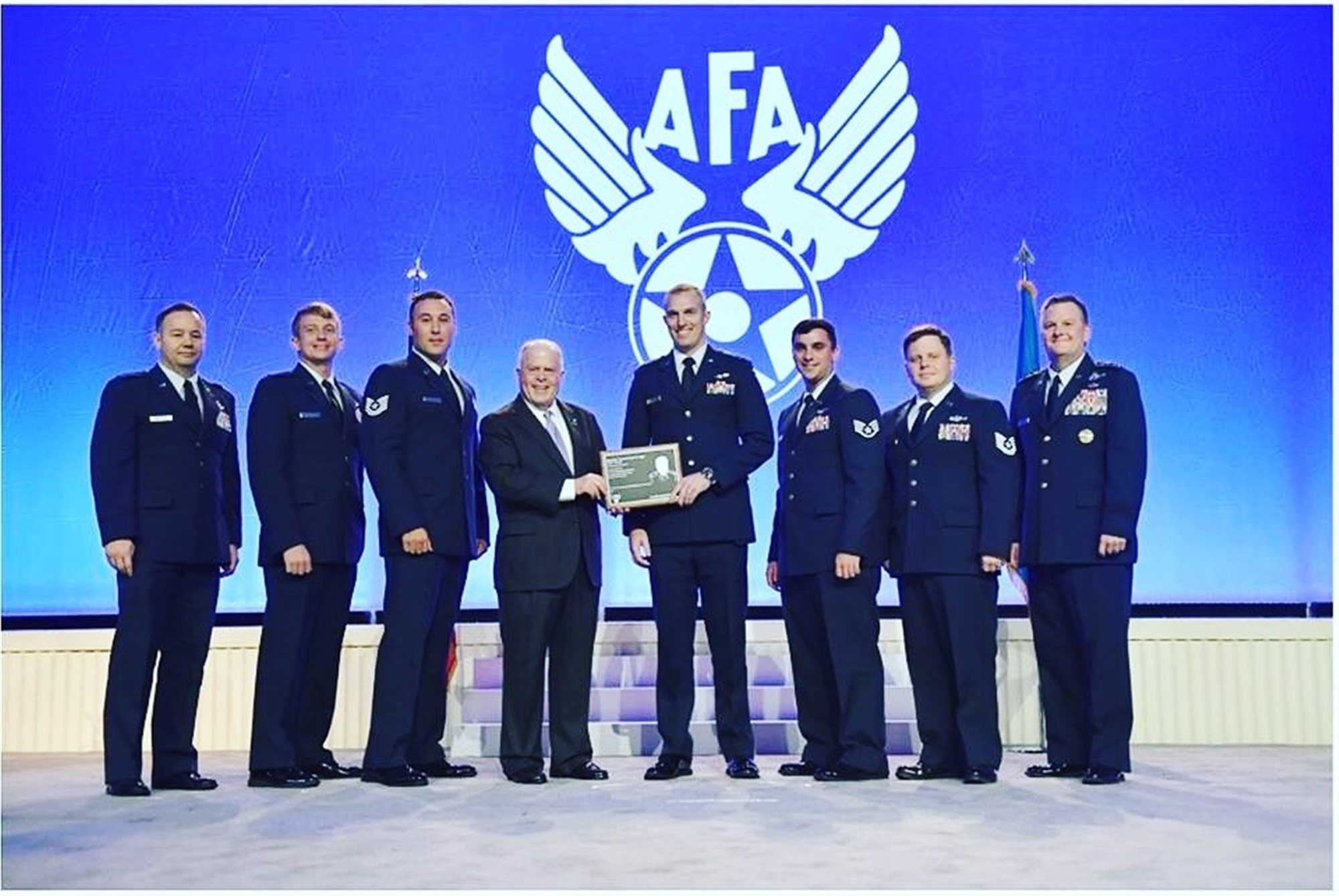 U.S. Air Force 17th Special Operations Squadron Air Commandos accept the Brigadier General Ross Hoyt award Sept. 18, 2017, at the Air Force Association National Convention in Washington D.C. The crew of JAKAL 11 received the Air Force level award for the heroic actions following an aircraft mishap. (Courtesy photo)