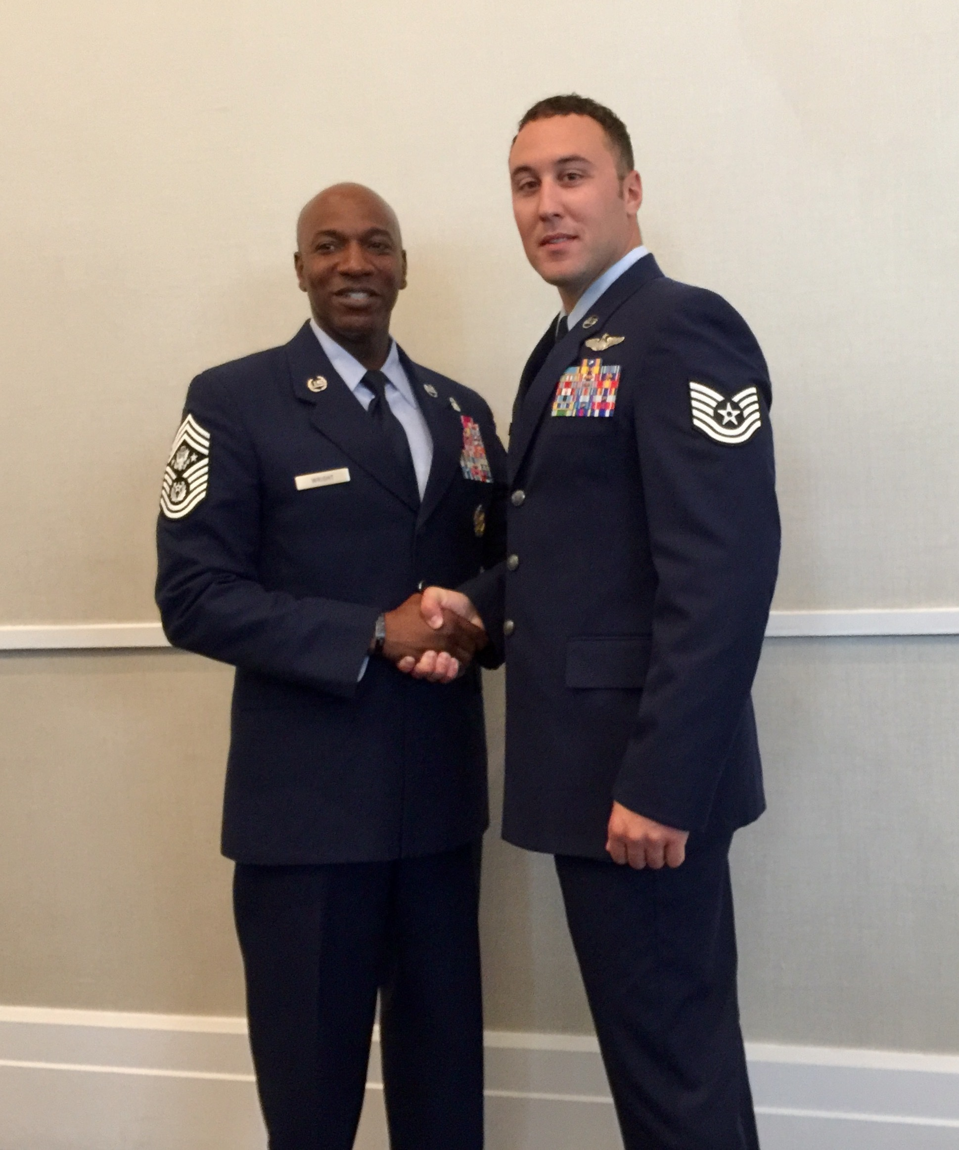 U.S. Air Force Tech. Sgt. Kade Bollinger poses for a photo with Chief Master Sergeant of the Air Force Kaleth Wright following his award recognition Sept. 18, 2017, at the Air Force Association National Convention in Washington D.C. Bollinger was a member of the crew that received the Air Force level award for the heroic actions following an aircraft mishap. (Courtesy photo)