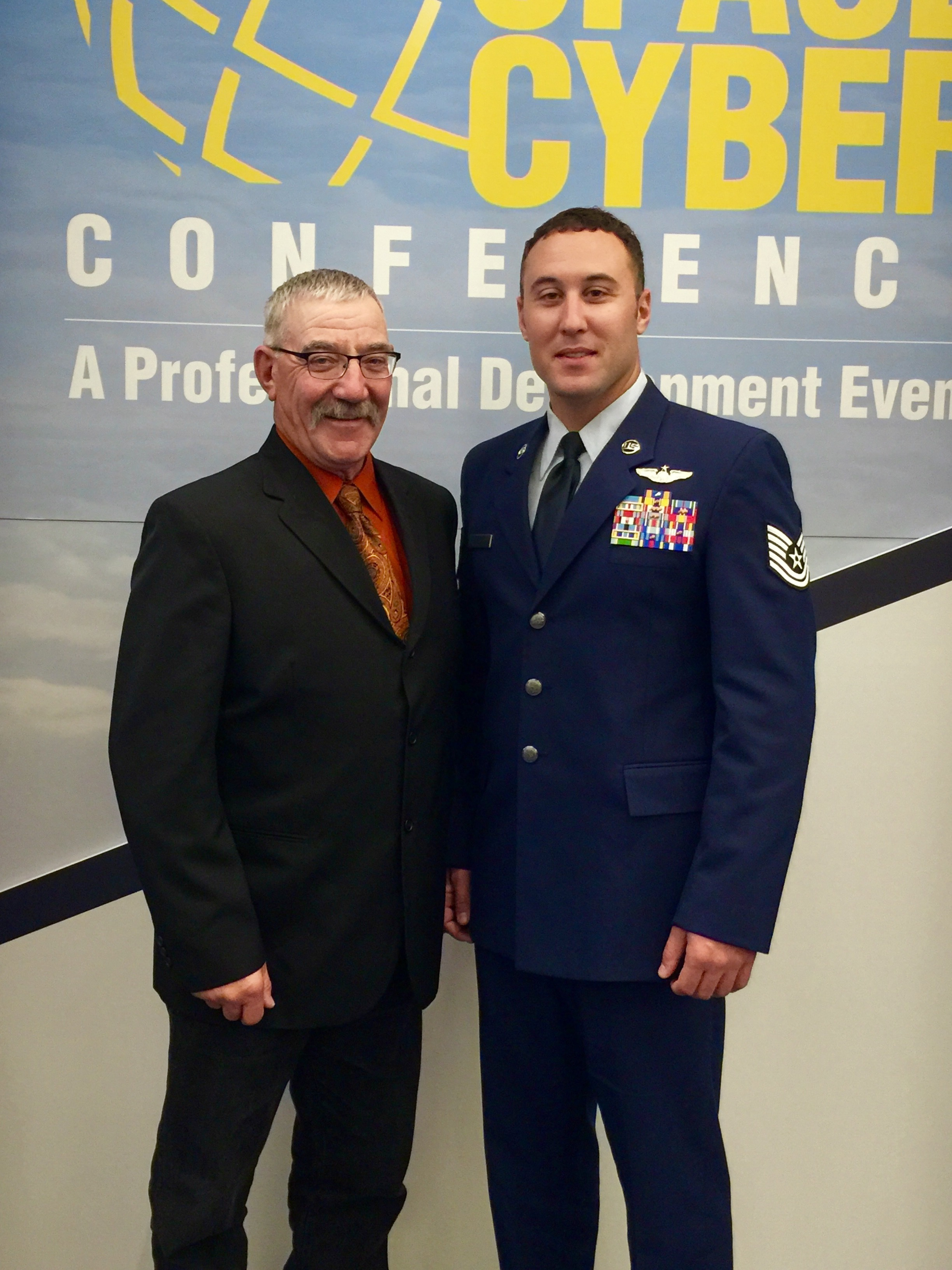 U.S. Air Force Tech. Sgt. Kade Bollinger poses for a photo with his father following his award recognition Sept. 18, 2017, at the Air Force Association National Convention in Washington D.C. Bollinger was a member of the crew that received the Air Force level award for the heroic actions following an aircraft mishap. (Courtesy photo)