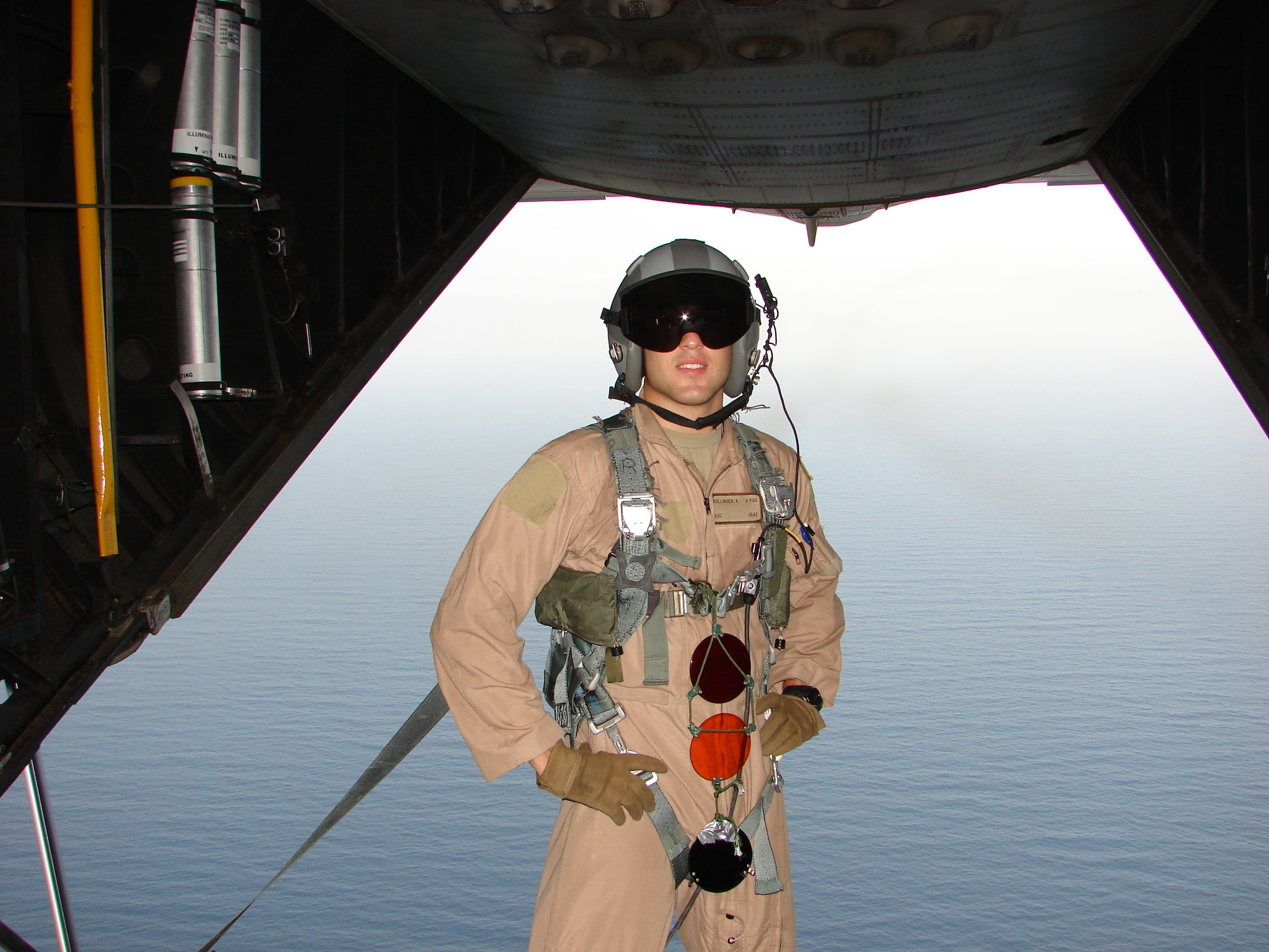U.S. Air Force Airman 1st Class Kade Bollinger poses on the ramp of a U.S. Air Force HC-130P King during his first deployment to the Horn of Africa in 2007. He had just completed helicopter air refueling with a U.S. Marine Corps MH-53 Super Stallion. (Courtesy photo)