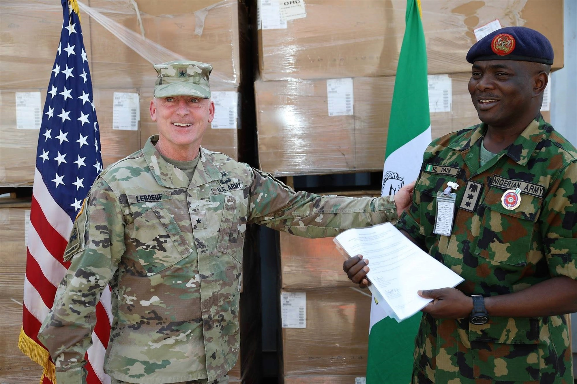 Brig. Gen. Eugene LeBoeuf, the U.S. Army Africa acting commanding general, meets with Col. R.L. Pam during an equipment handover between the U.S. Embassy to Nigeria and Nigeria army's 20th Infantry Battalion in Abuja, Nigeria. LeBoeuf's engagement in Nigeria also included a senior leader engagement with the U.S. ambassador to Nigeria and Nigeria's chief of army staff, and a speech to students at the Nigeria Army War College. (Courtesy photo/U.S. Embassy and Consulate in Nigeria)