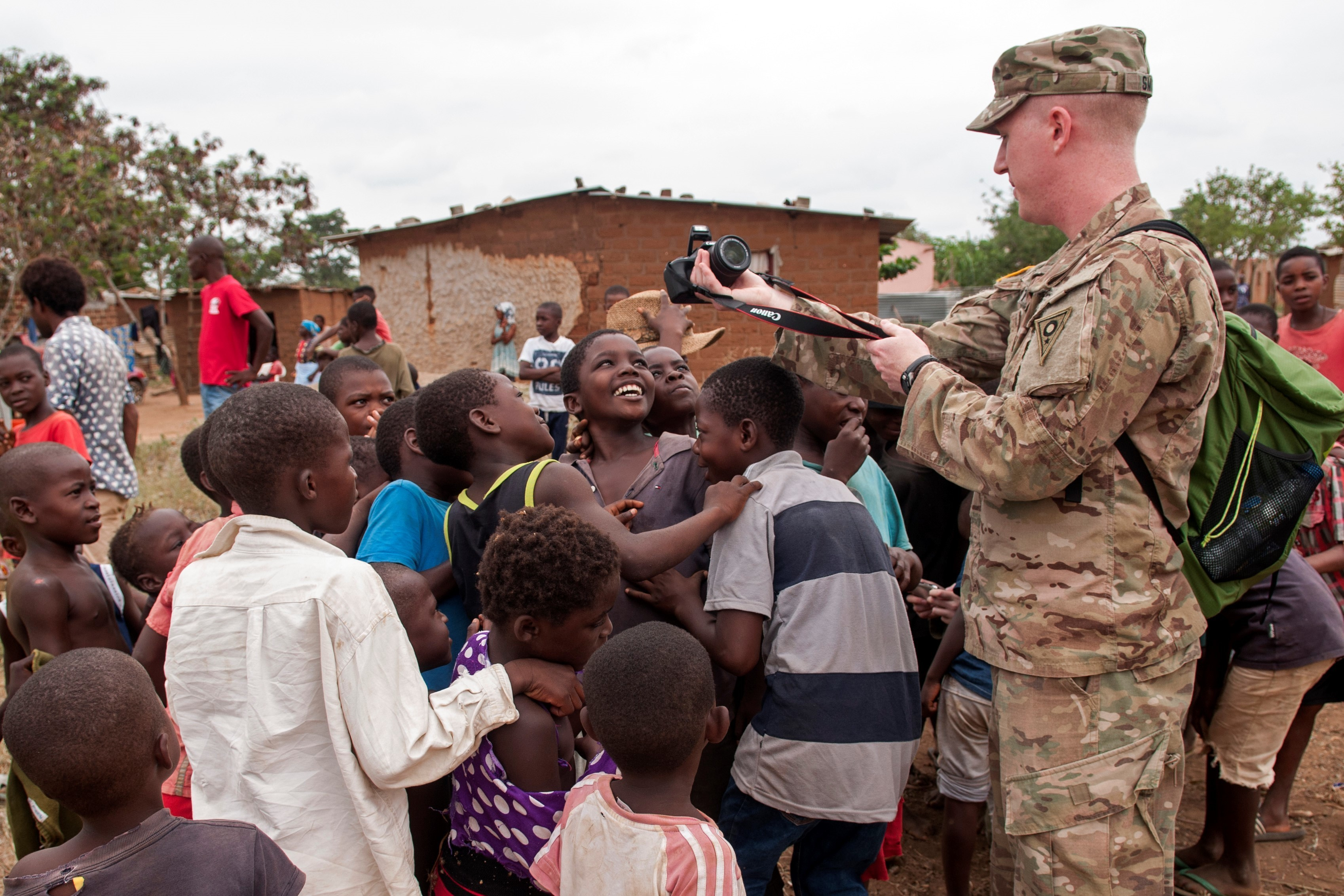 Sgt. Zachary Smith, an Ohio Army National Guard medic participating in PAMBALA 2017, interacts with the local children in the village of Vale do Paraiso Dec. 9, 2017, in Bengo, Angola. PAMBALA, the first-ever trilateral combined medical engagement to take place in the Republic of Angola, is an agreement between the Angolan Armed Forces, Serbian Armed Forces and the Ohio National Guard to share best practices, strengthen medical treatment processes, establish new relationships and nurture established partnerships. (Ohio National Guard photo by Staff Sgt. Wendy Kuhn)