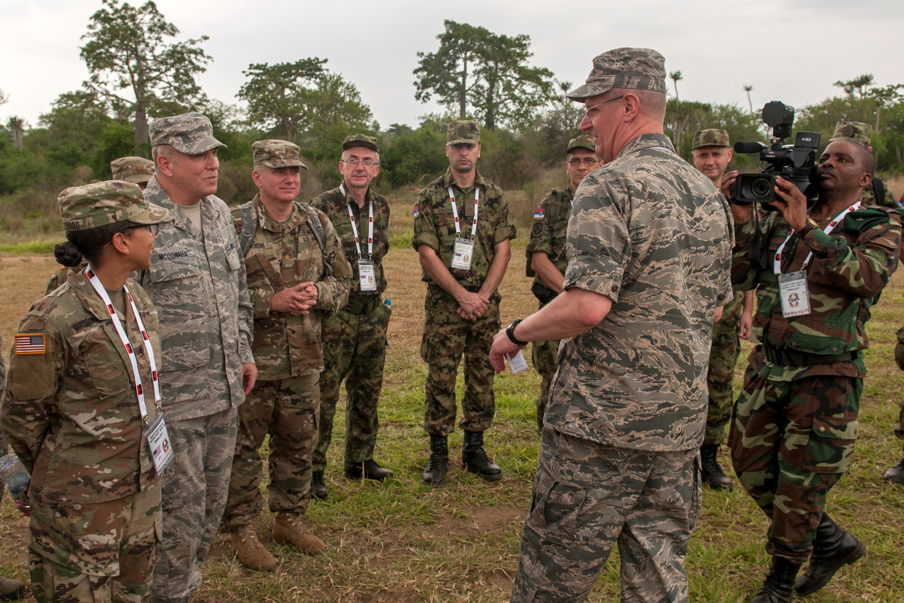 Maj. Gen. Mark E. Bartman, Ohio adjutant general, speaks with members of the Angolan Armed Forces, Serbian Armed Forces and the Ohio National Guard during the PAMBALA 2017 medical exercise Dec. 9, 2017, in Bengo, Angola. PAMBALA, the first-ever trilateral combined medical engagement to take place in the Republic of Angola, is an agreement between the Angolan Armed Forces, Serbian Armed Forces and the Ohio National Guard to share best practices, strengthen medical treatment processes, establish new relationships and nurture established partnerships. (Ohio National Guard photo by Staff Sgt. Wendy Kuhn)