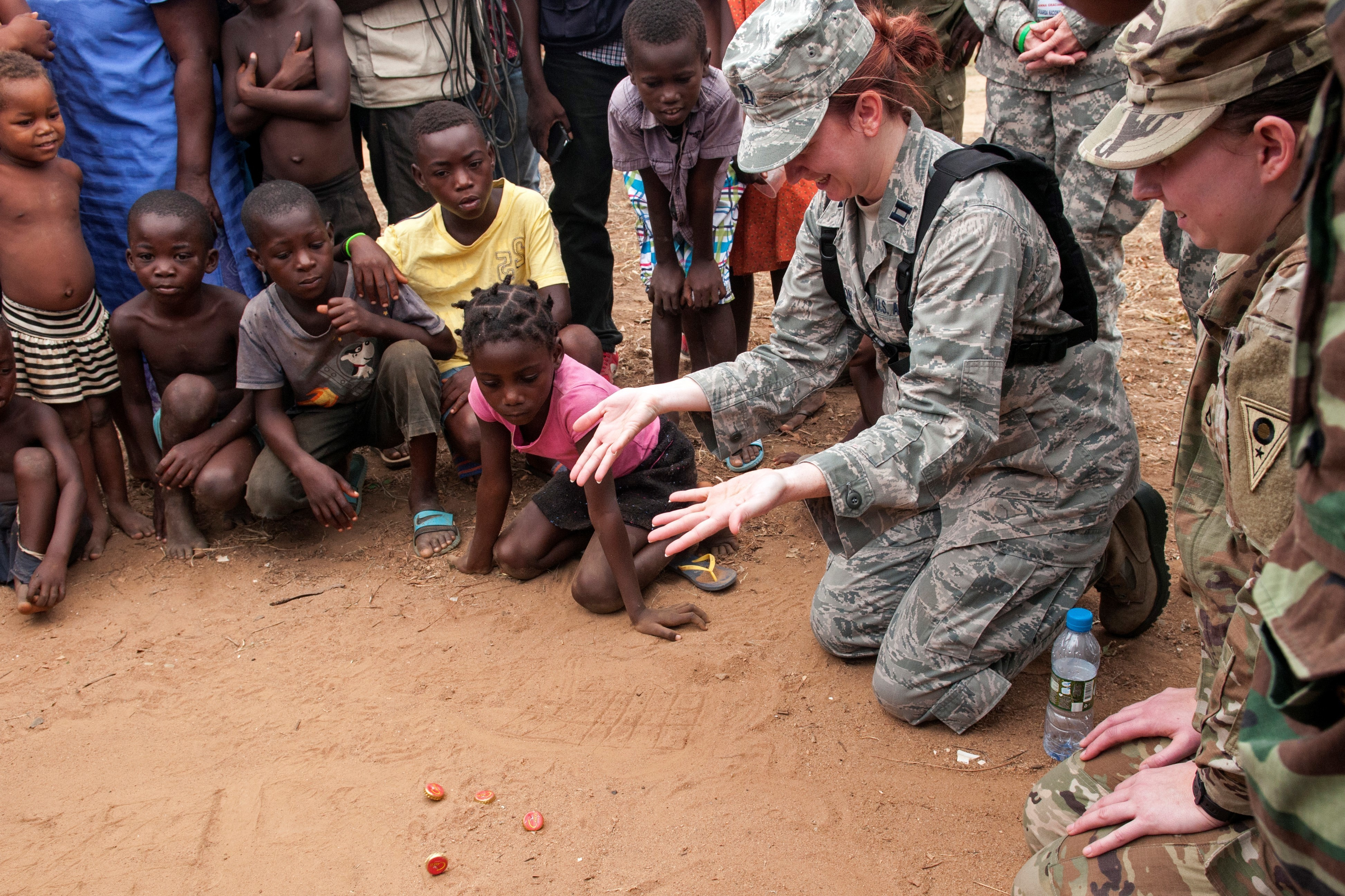 Capt. Sarah Woodson, a nurse with the Ohio Air National Guard, plays a game with the local children in the village of Vale do Paraiso during the PAMBALA medical exercise Dec. 9, 2017, in Bengo, Angola. PAMBALA, the first-ever trilateral combined medical engagement to take place in the Republic of Angola, is an agreement between the Angolan Armed Forces, Serbian Armed Forces and the Ohio National Guard to share best practices, strengthen medical treatment processes, establish new relationships and nurture established partnerships. (Ohio National Guard photo by Staff Sgt. Wendy Kuhn)