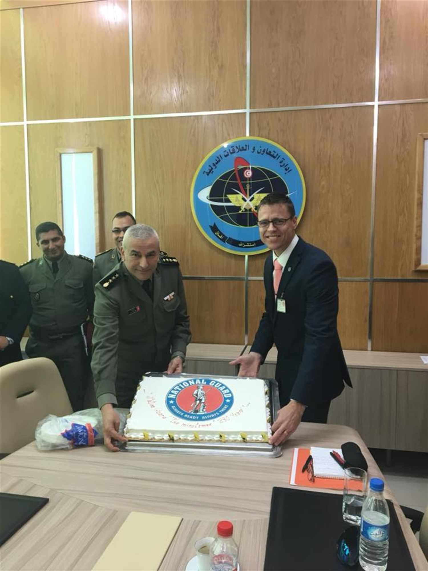 Capt. Neal, Wyoming National Guard and Tunisia Bilateral Affairs Officer and Colonel Skhiri of the Tunisian Armed Forces cut cake to celebrate the National Guard Birthday.